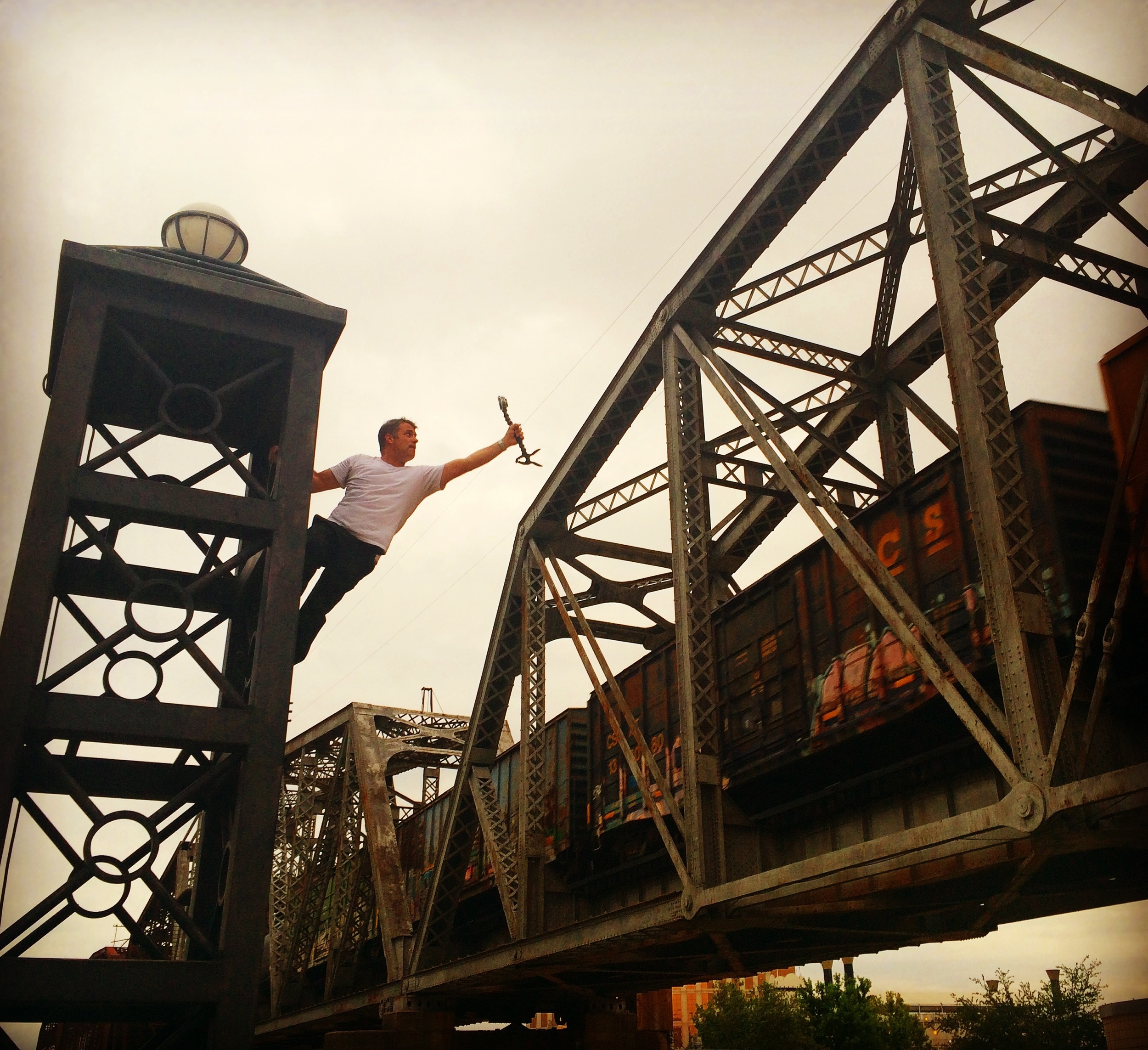 Shooting a passing elevated train in Shreveport, La. WOWMI tour, spring 2016. Photo by: Cara Salmeri