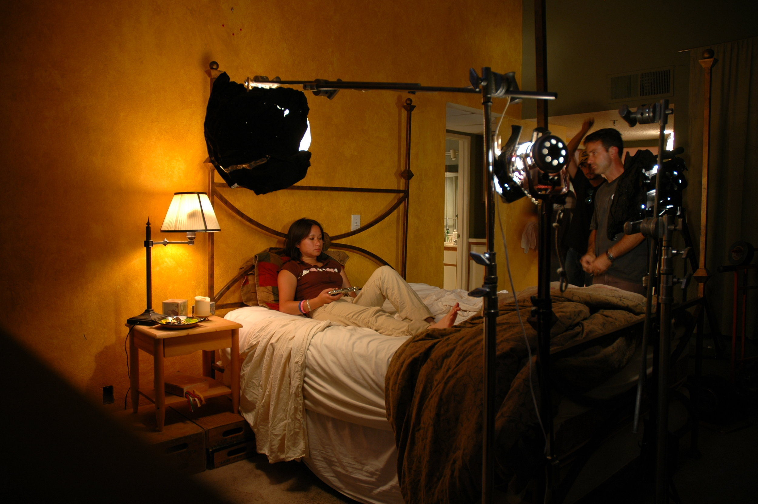"DP Matt Mania lights a stand-in on the set of ""Bedtime Story."" Hollywood summer 2005. Photo by Topher Hopkins."