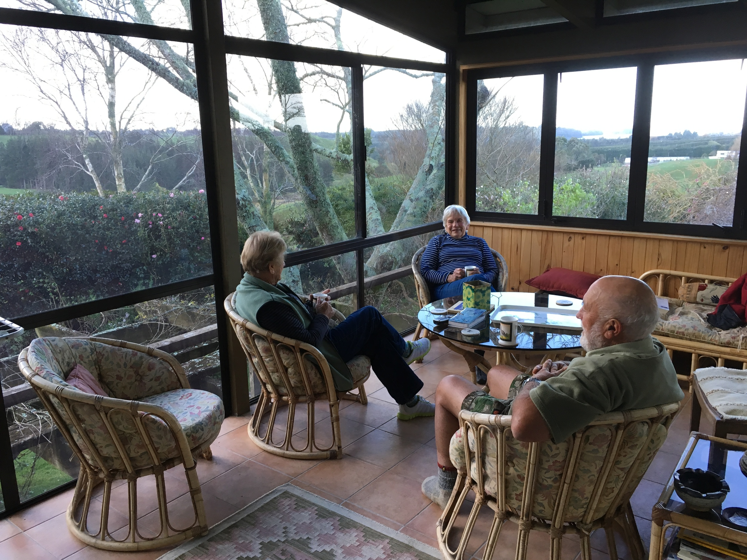 BnB Hosts: MaryAnne (Centre) and Rod (Right), in their sun room overlooking the Katikati District.