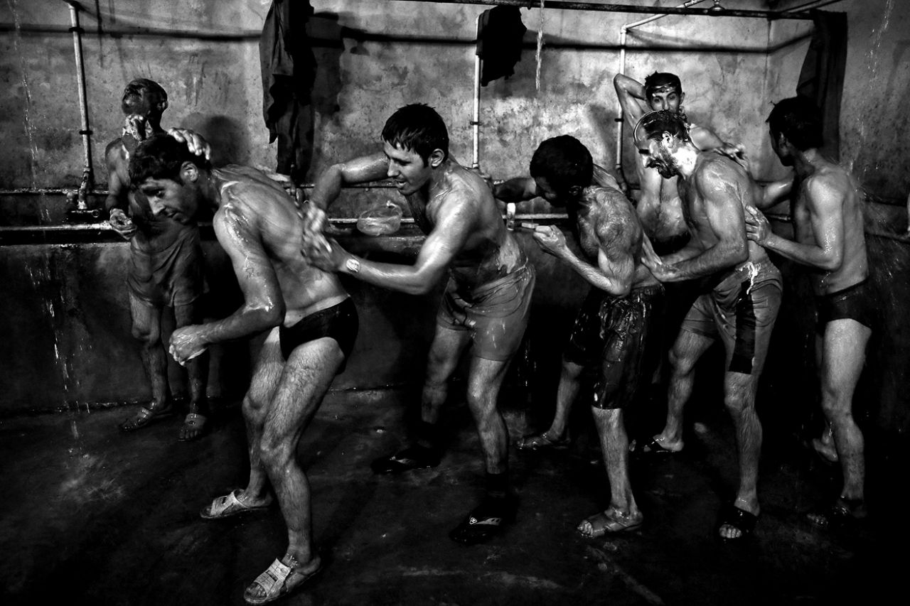 Iranian coal miners shower after a long day of work at a mine near the city of Zirab 132 miles northeast of the capital Tehran on a mountain in Mazandaran province, Iran on May 6, 2014. (Photo: Ebrahim Noroozi/AP)