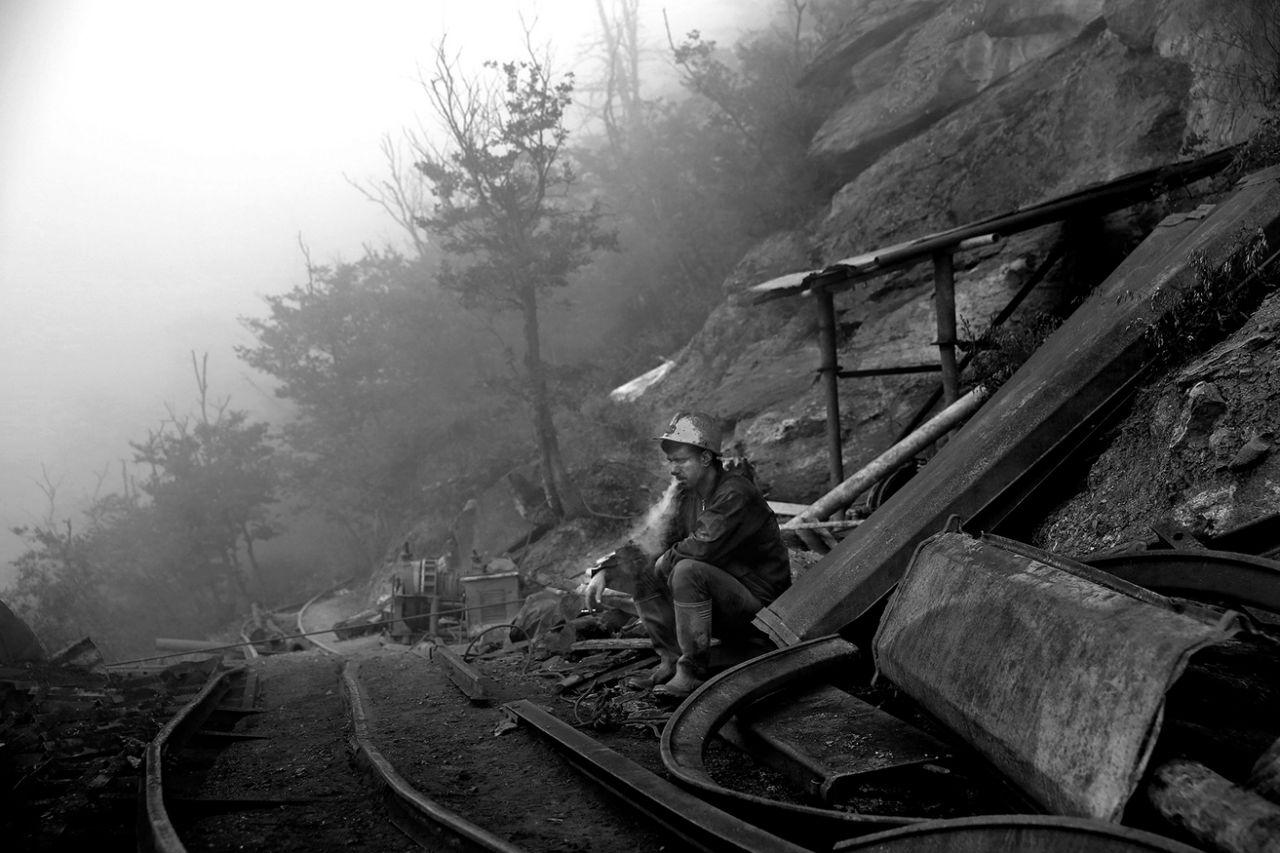 An Iranian coal miner takes a break at a mine near the city of Zirab 132 miles northeast of the capital Tehran on a mountain in Mazandaran province, Iran on May 8, 2014. (Photo: Ebrahim Noroozi/AP)