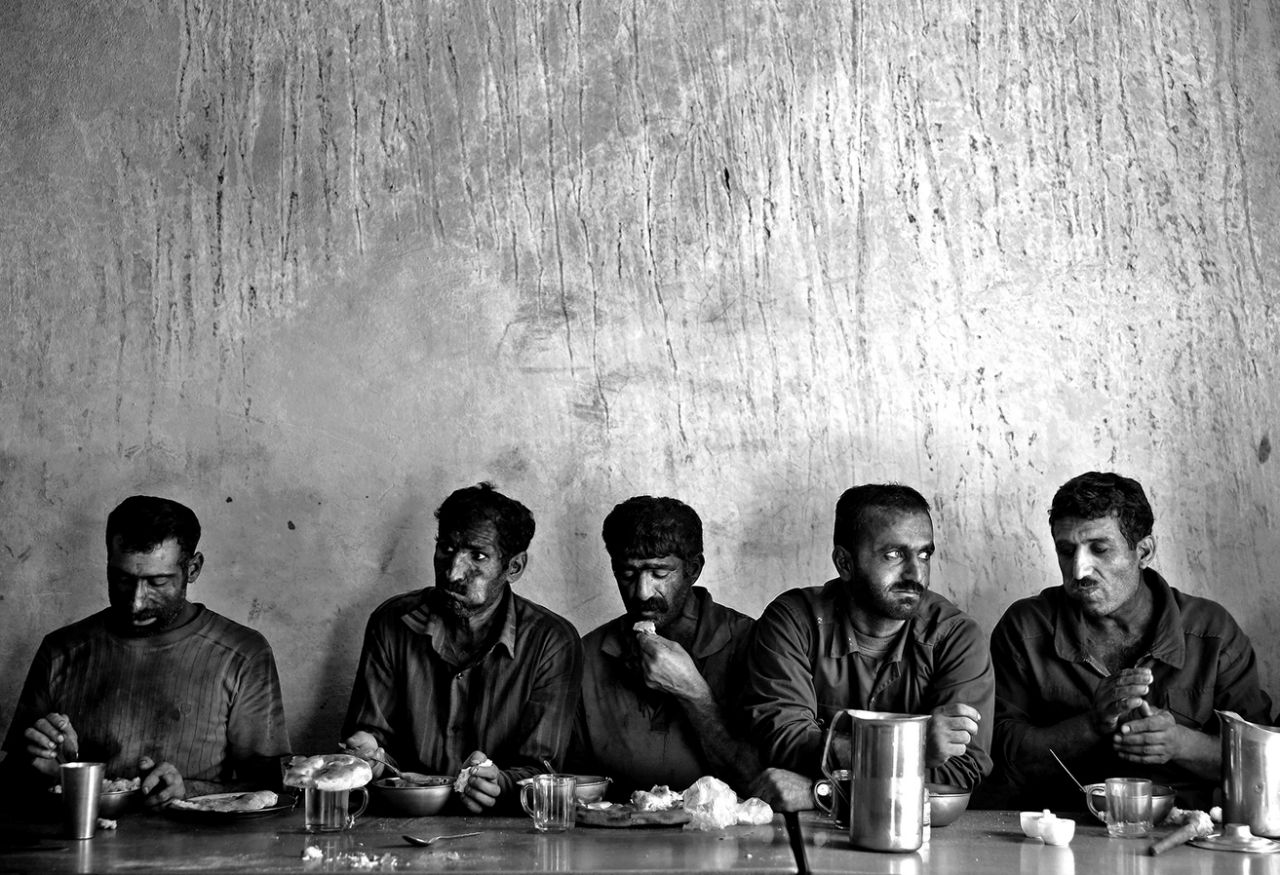 Iranian coal miners eat lunch at a mine near the city of Zirab 132 miles northeast of the capital Tehran on a mountain in Mazandaran province, Iran on Aug. 19, 2014. (Photo: Ebrahim Noroozi/AP)