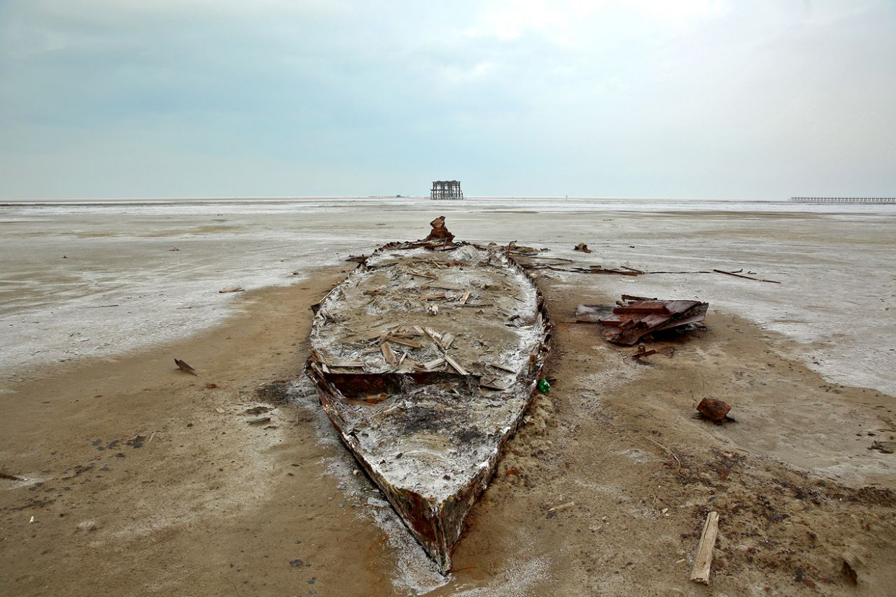 The wreckage of a boat is stuck in the solidified salts and sands at Lake Oroumieh, northwestern Iran, Feb. 16, 2014. (Photo: Ebrahim Noroozi/AP)