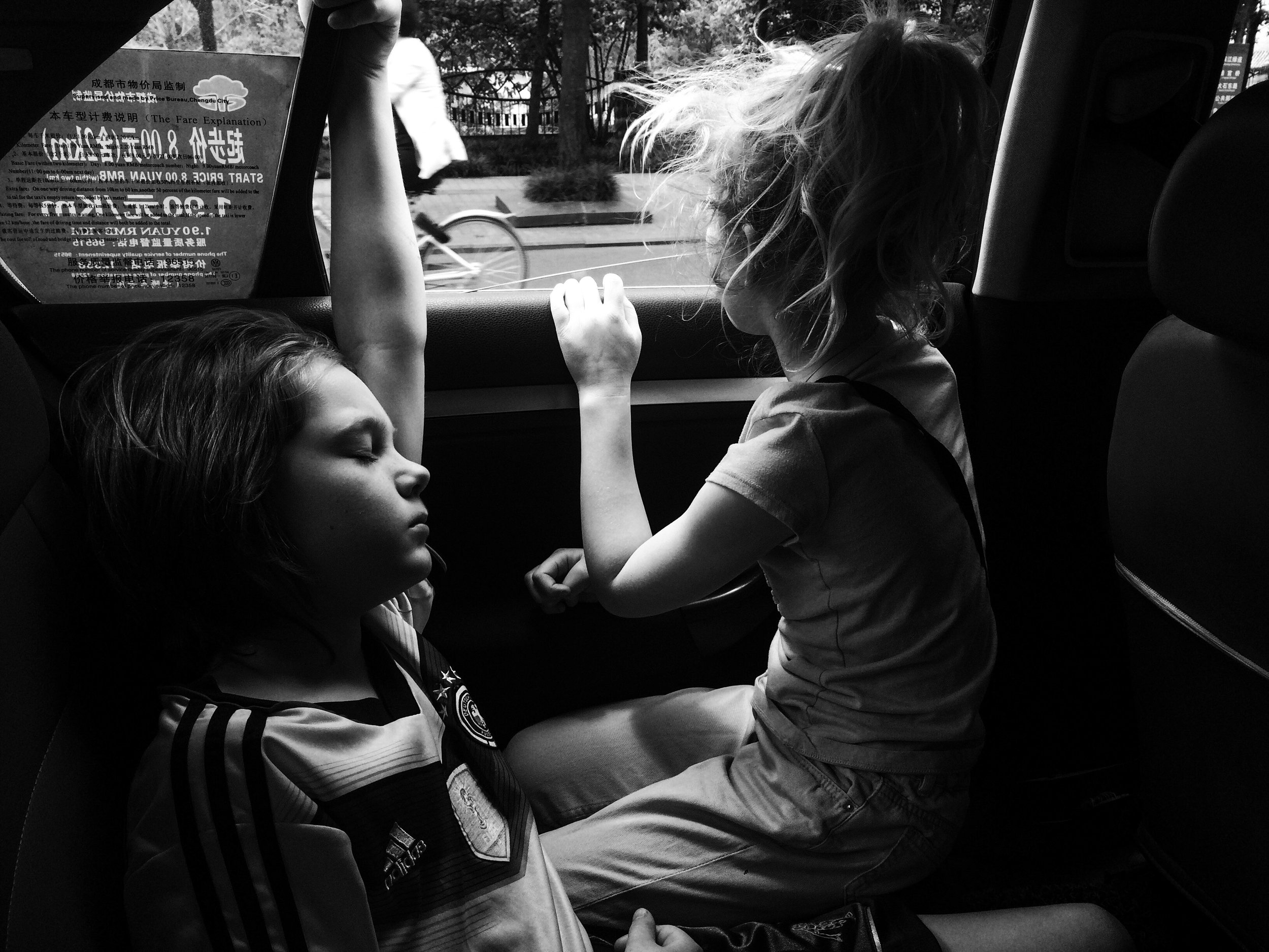Taxi rides : not the safest, but the best. Judah loves the wind in his hair, and Eden, our window watcher, loves the show.
