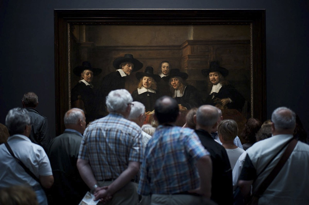 """Interesting Moment - 2nd Place, People. Museum visitors curiously watching Rembrandt's painting """"Syndics of the Drapers' Guild"""" where it gave the illusion that the people on the paintings too are curiously watching the visitors."""