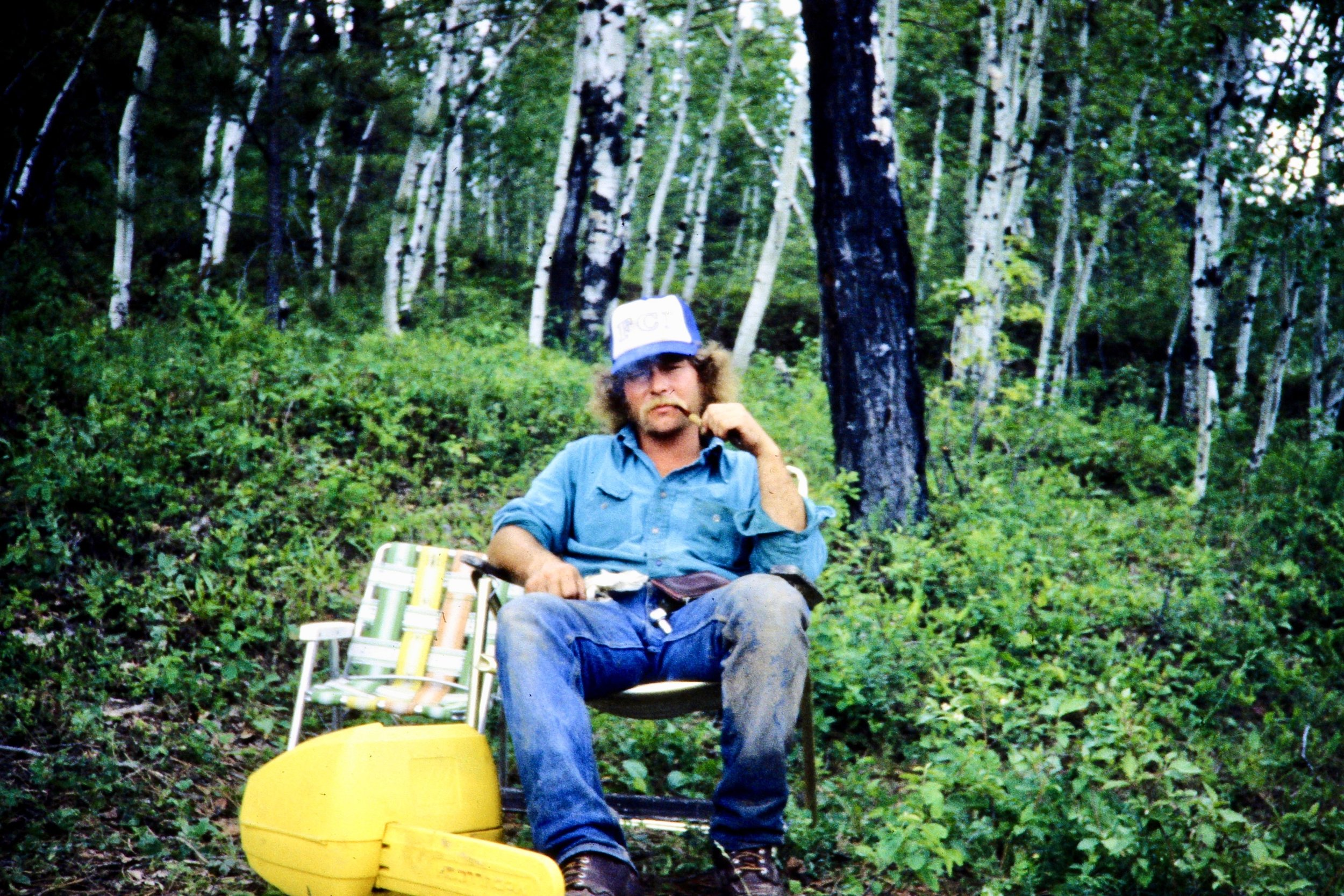 """This is my dad as he appears in my mind - in the woods, ready to cut firewood, pipe in hand."""