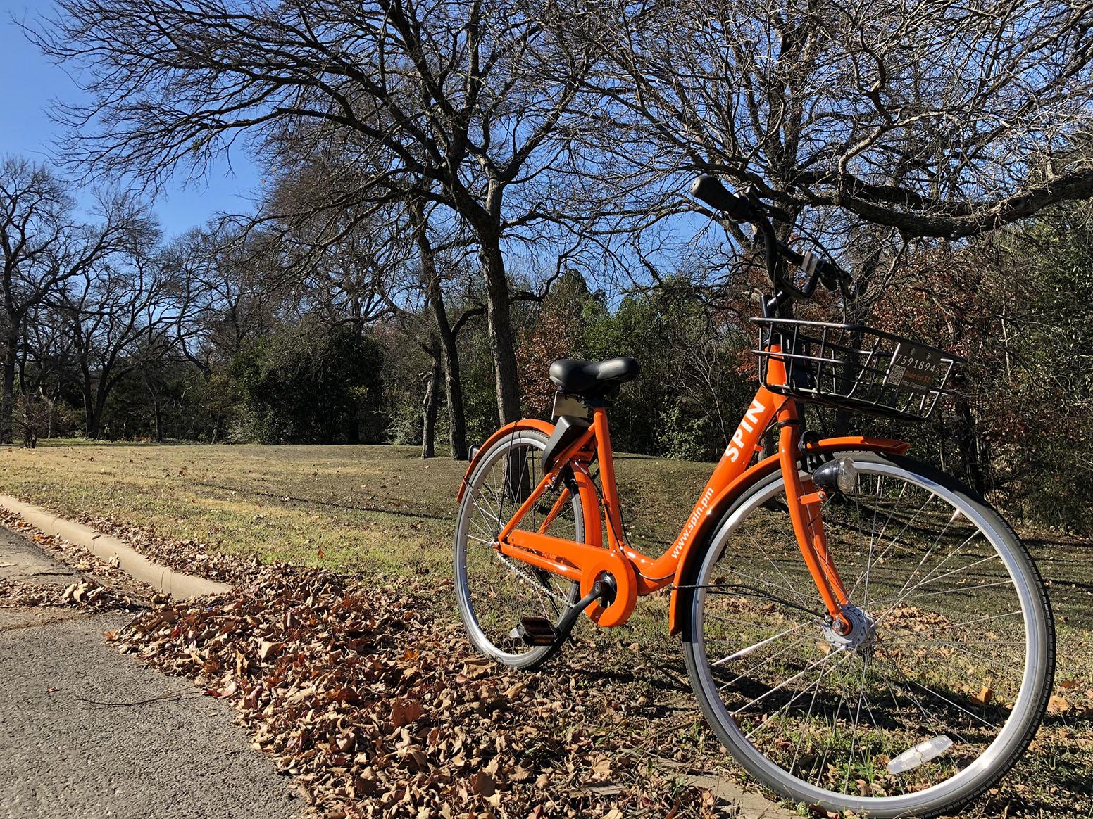 An orange SPIN bike spotted along Elmwood Blvd.