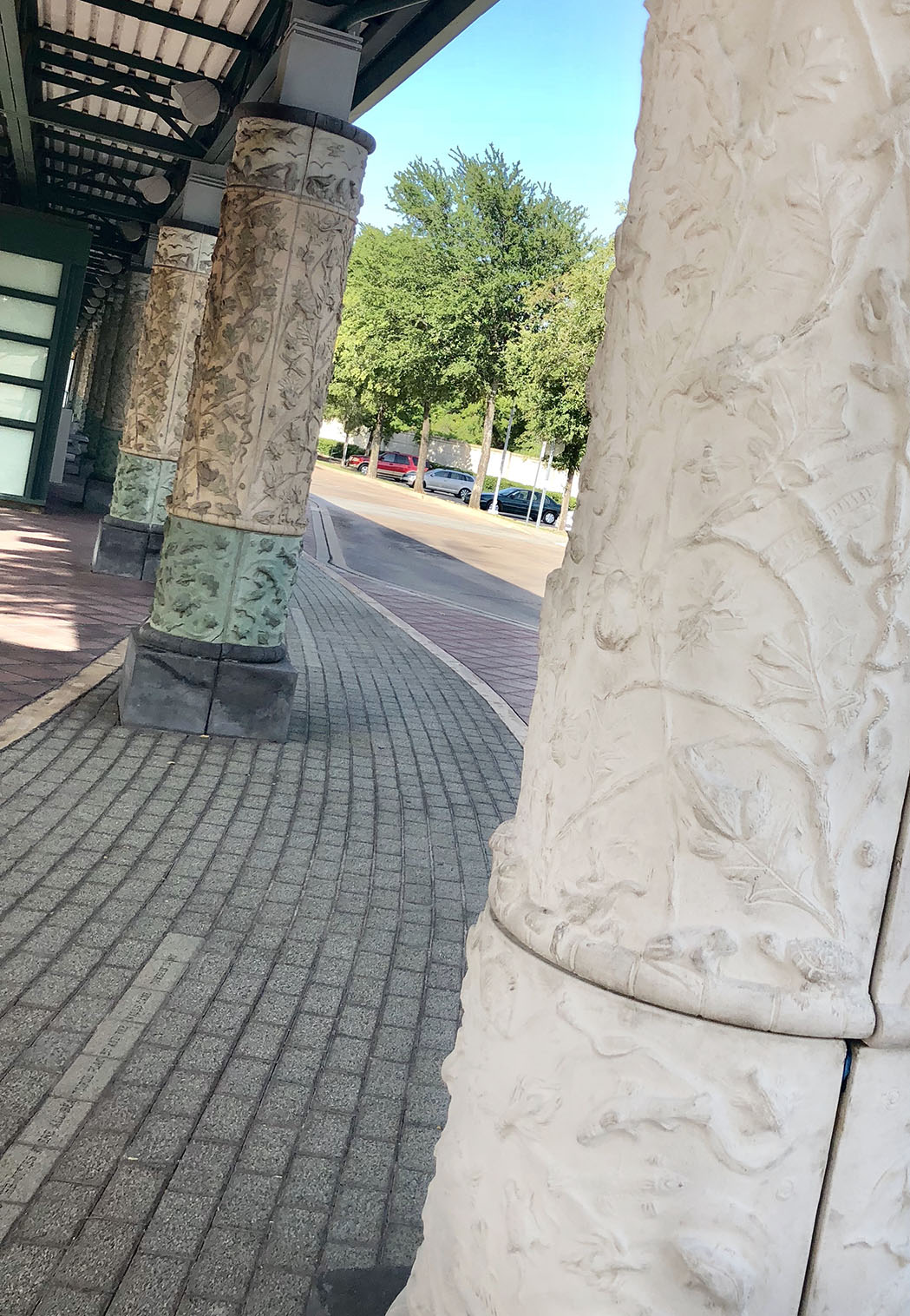 Newly installed column (foreground) with 22-year-old columns (background) and Vaughan lyrics inscribed in pavers.