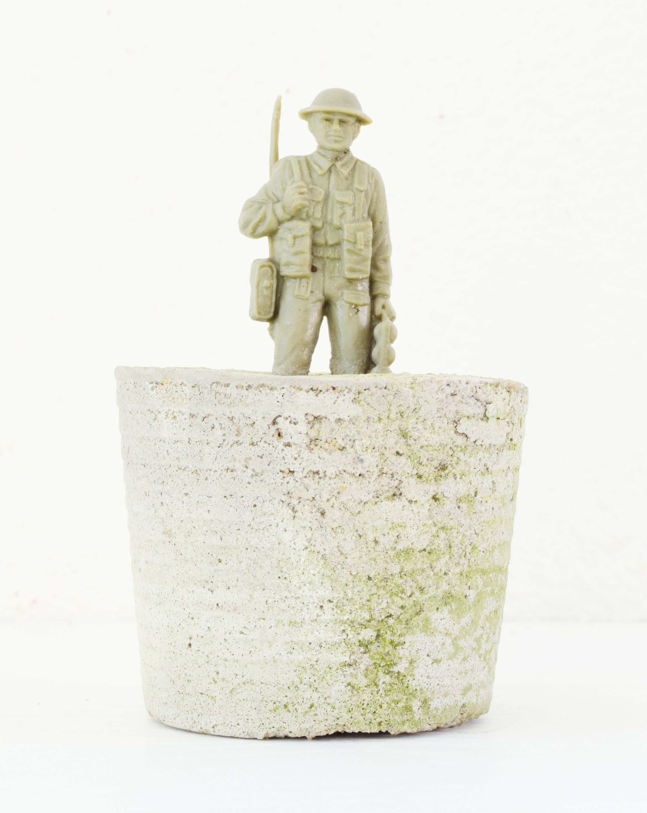 'COMMUTE' 2014    Concrete and plastic soldier 10 x 5 x 2 cm