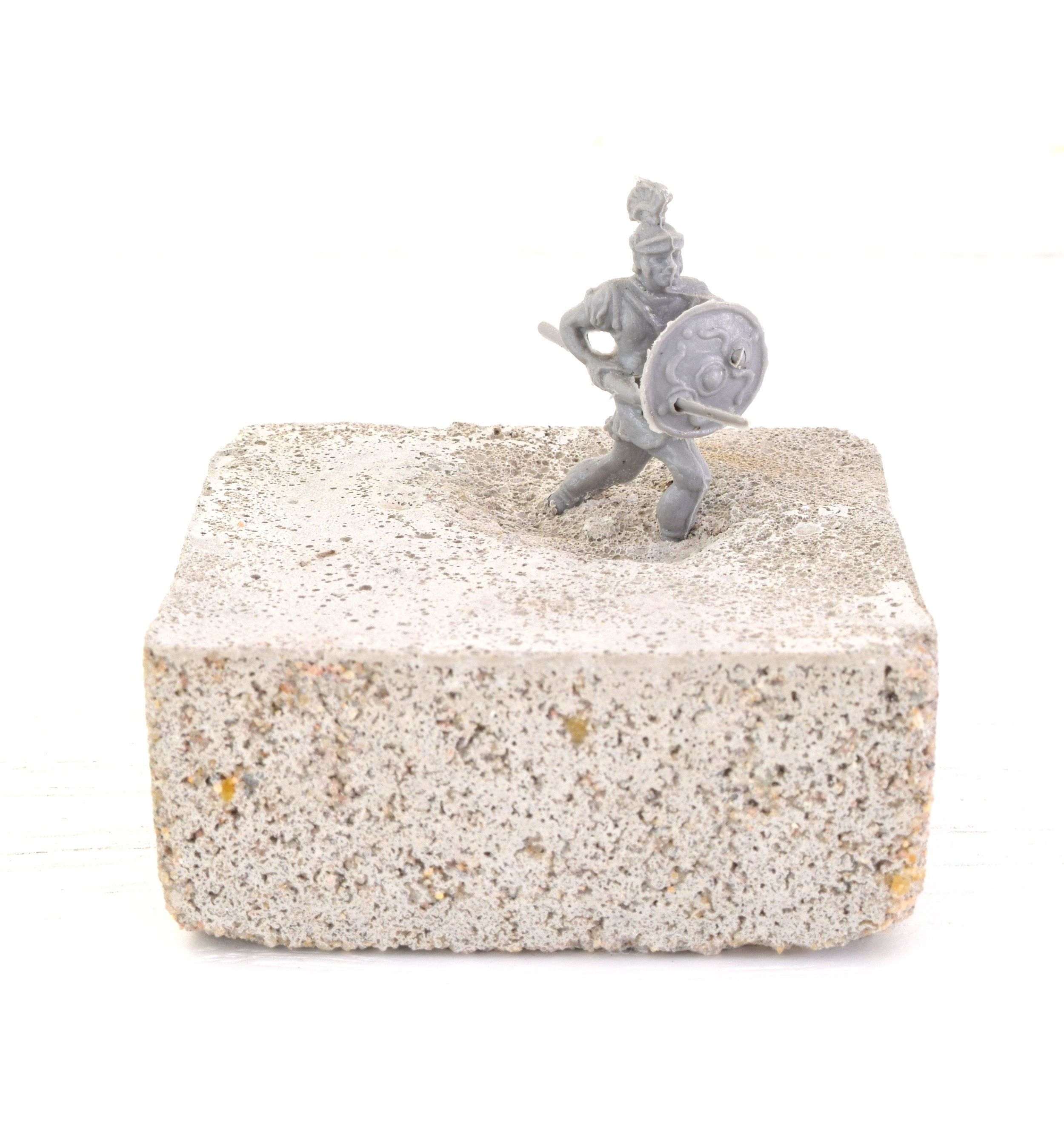 'UNTITLED' 2015    Concrete and plastic Roman soldier 4 x 4 x 2 cm