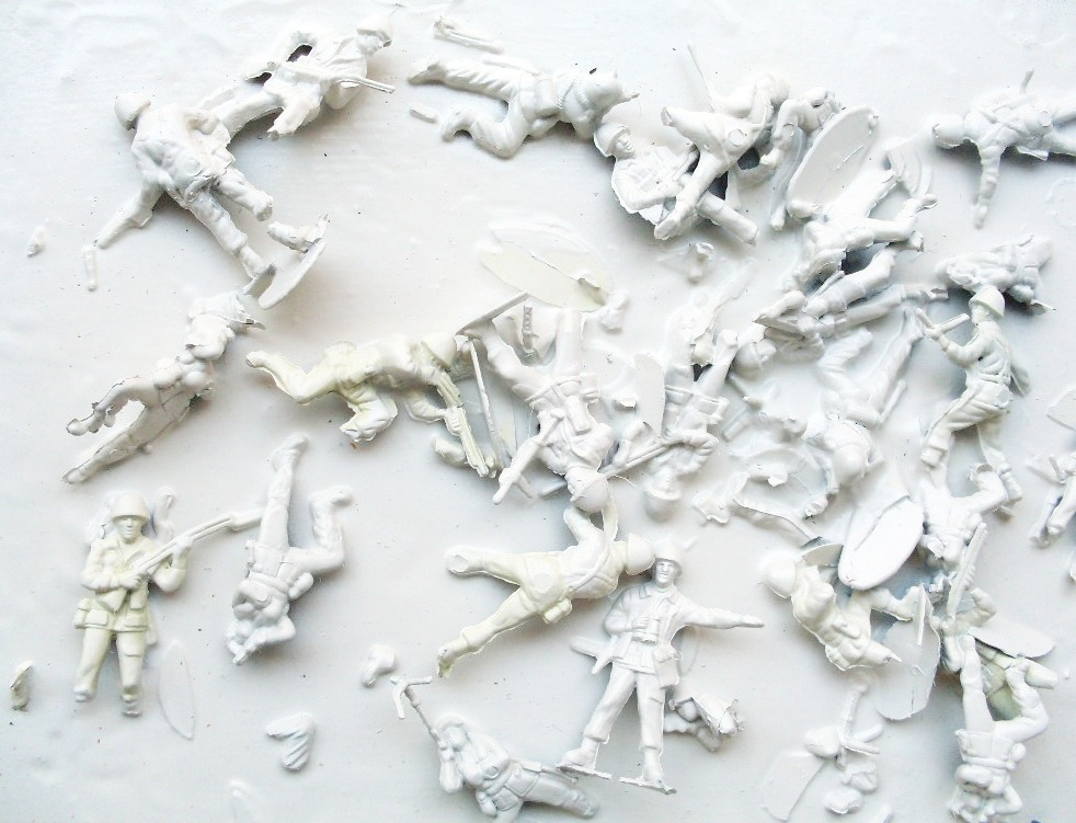 'TIDES' 2009    Plastic toy soldiers, PVA glue and spray paint on canvas 20 x 30 x 3 cm