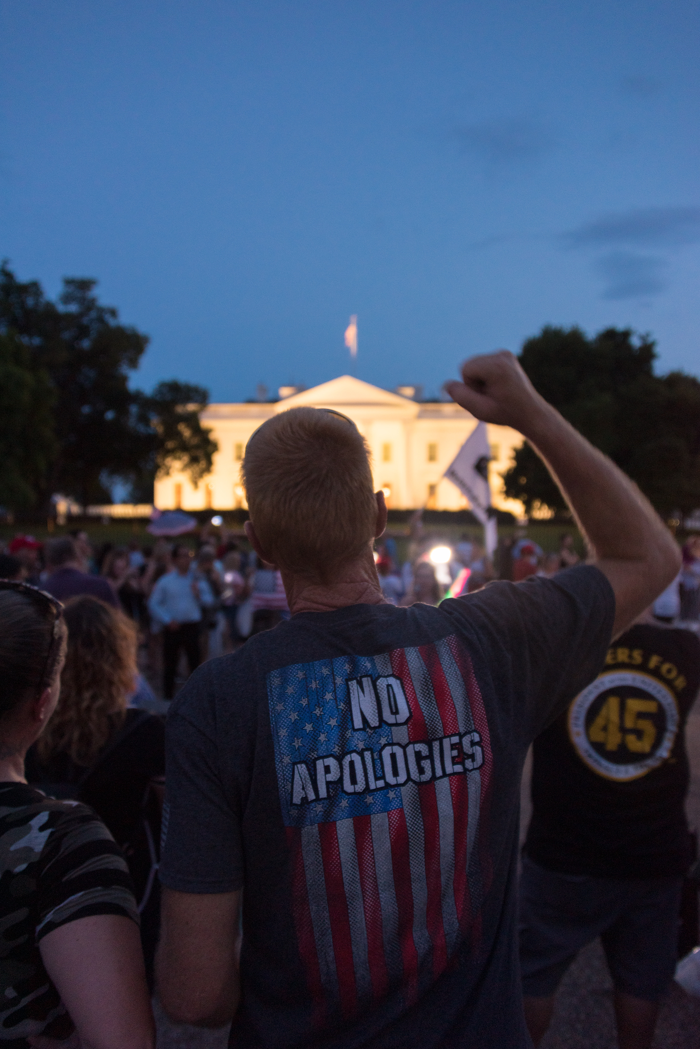 A crowd of pro-Trump supporters gathers outside the White House the evening before the capitol 4th of July celebrations.