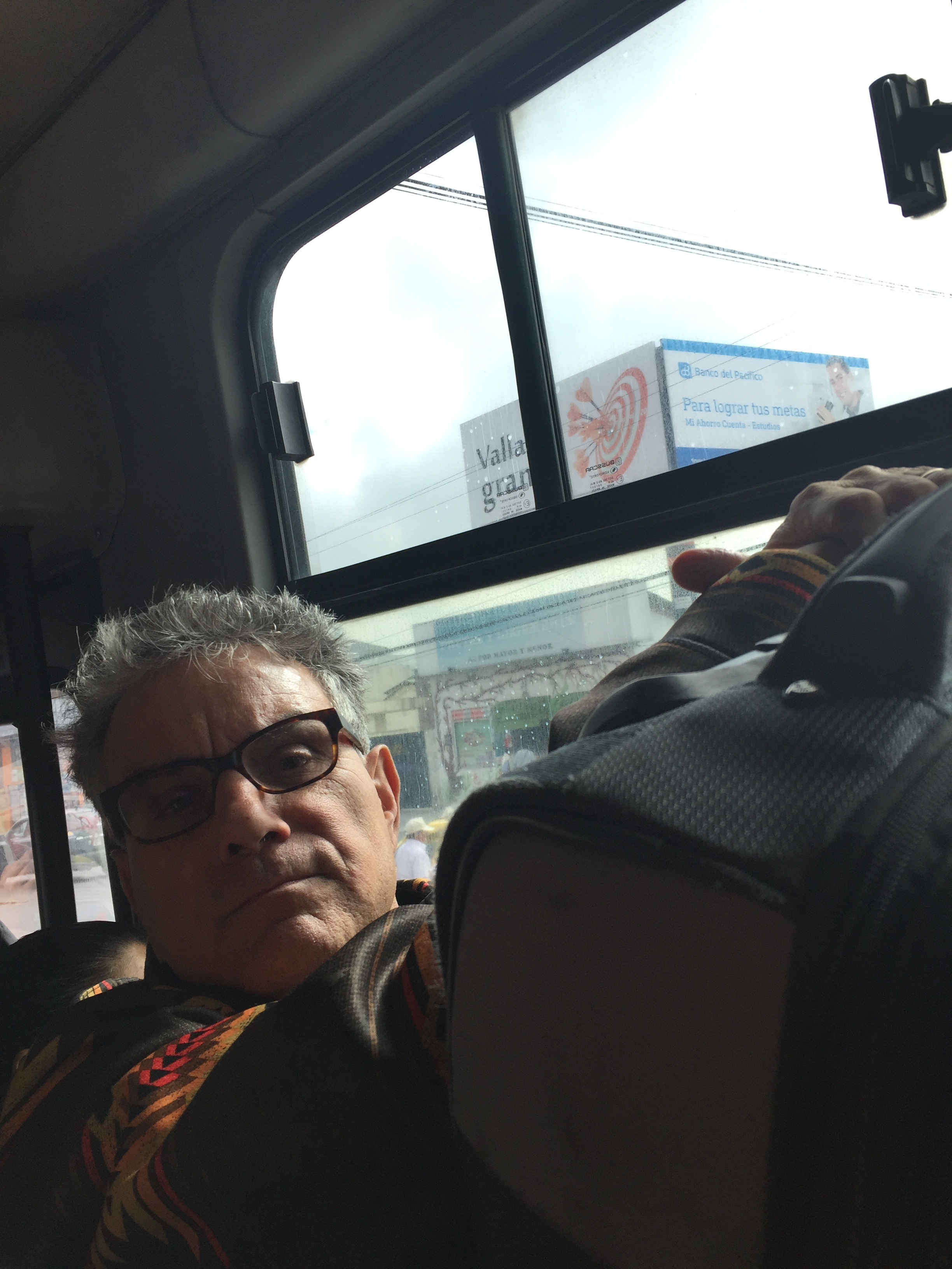 Frank on the local bus with our big bags