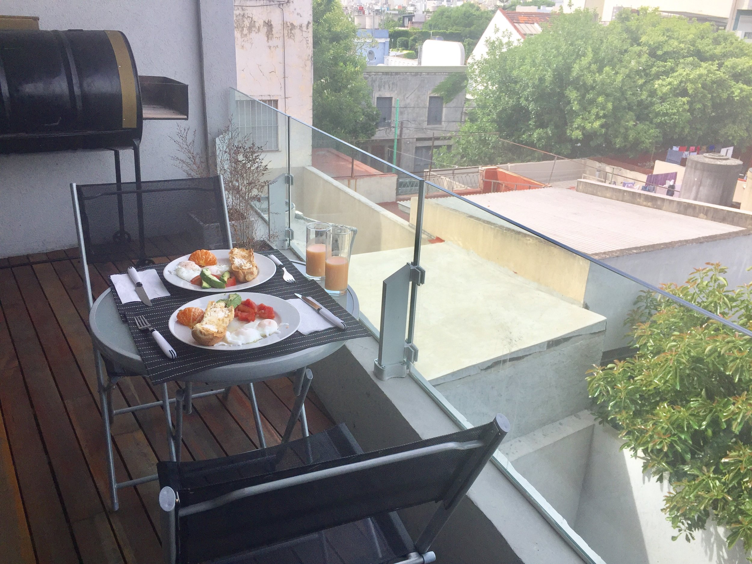 Breakfast on the balcony of our Airbnb
