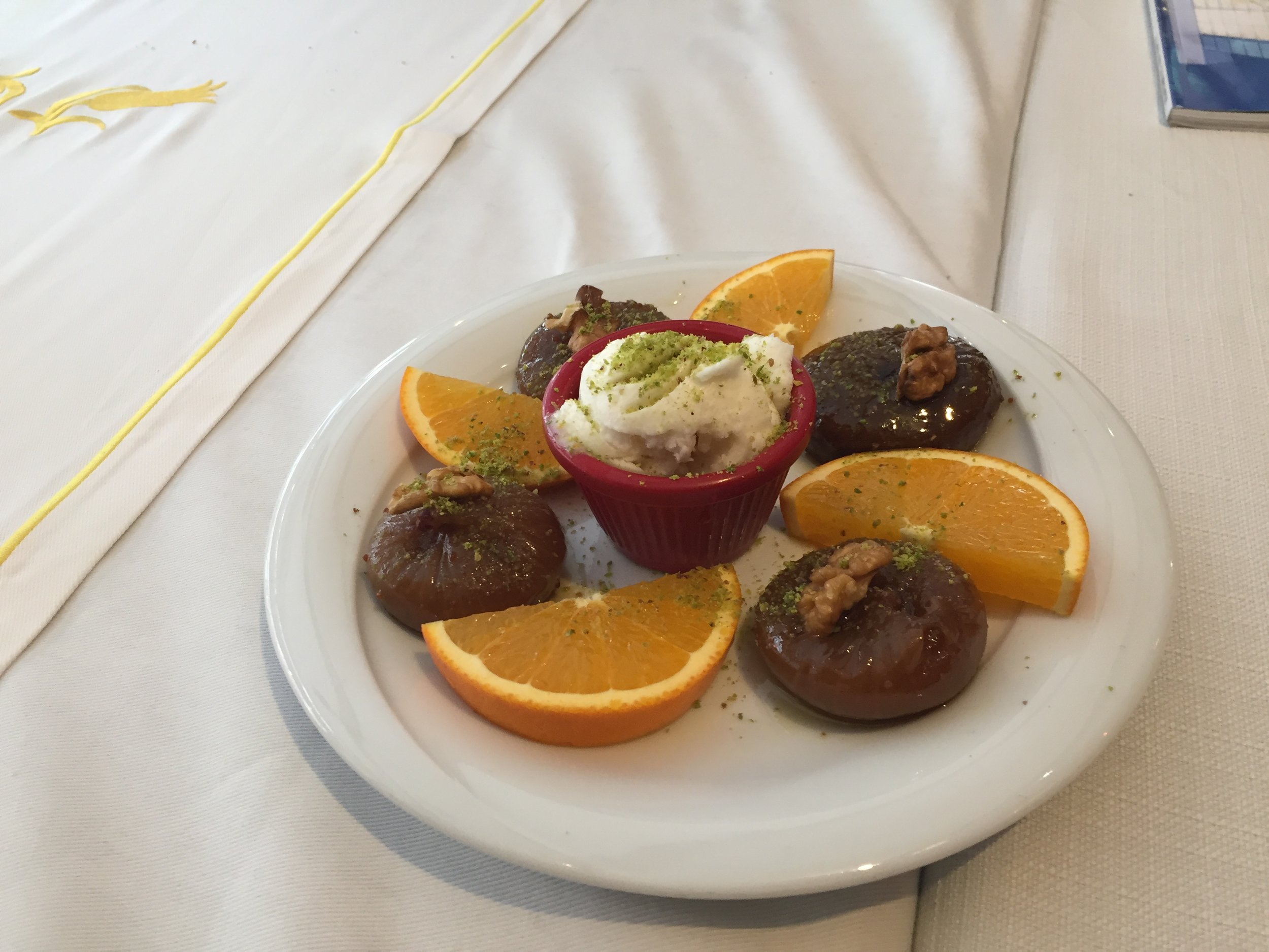 Typical Dessert of figs, ice cream and oranges