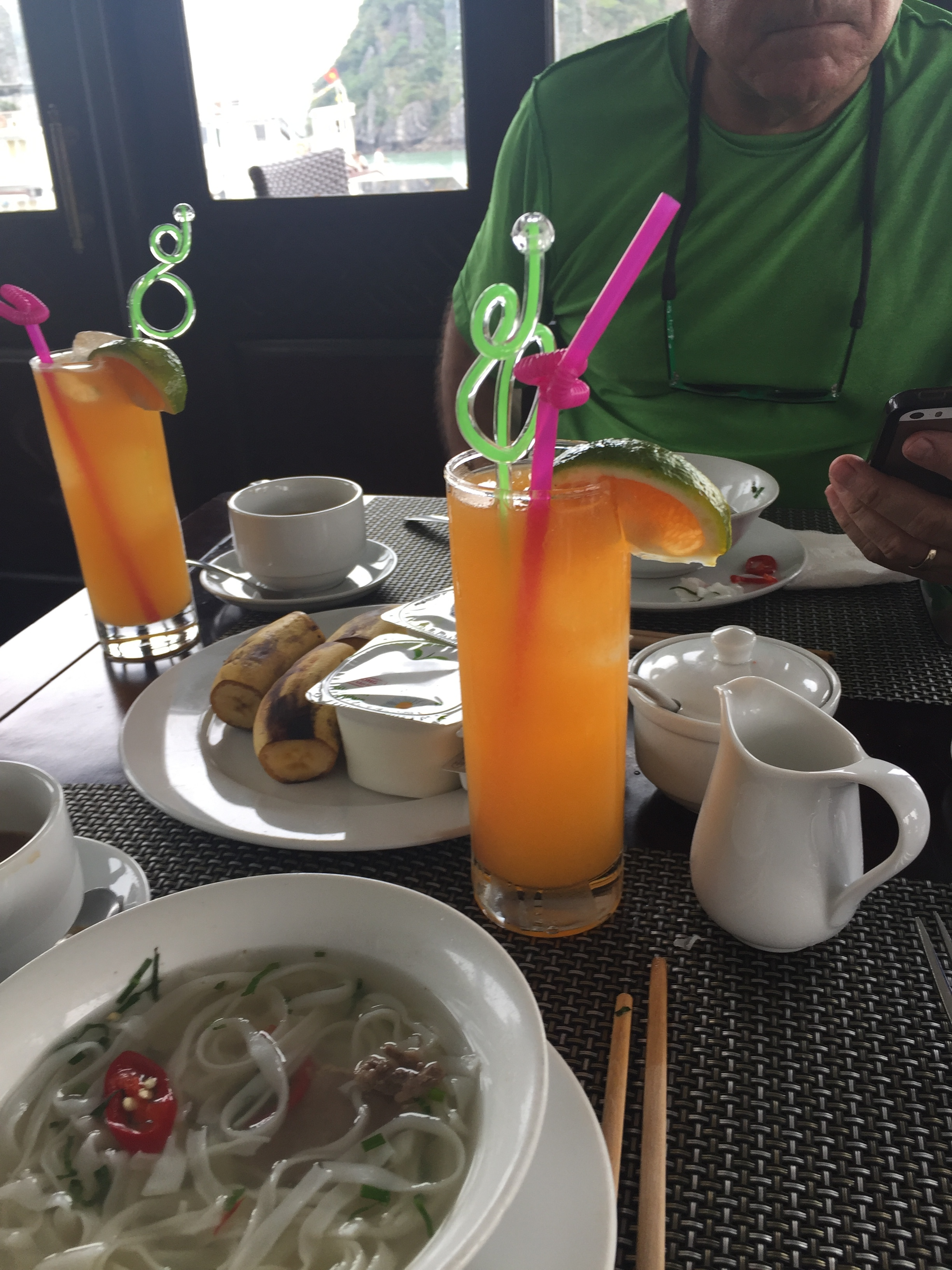 Breakfast of noodles and fresh juice