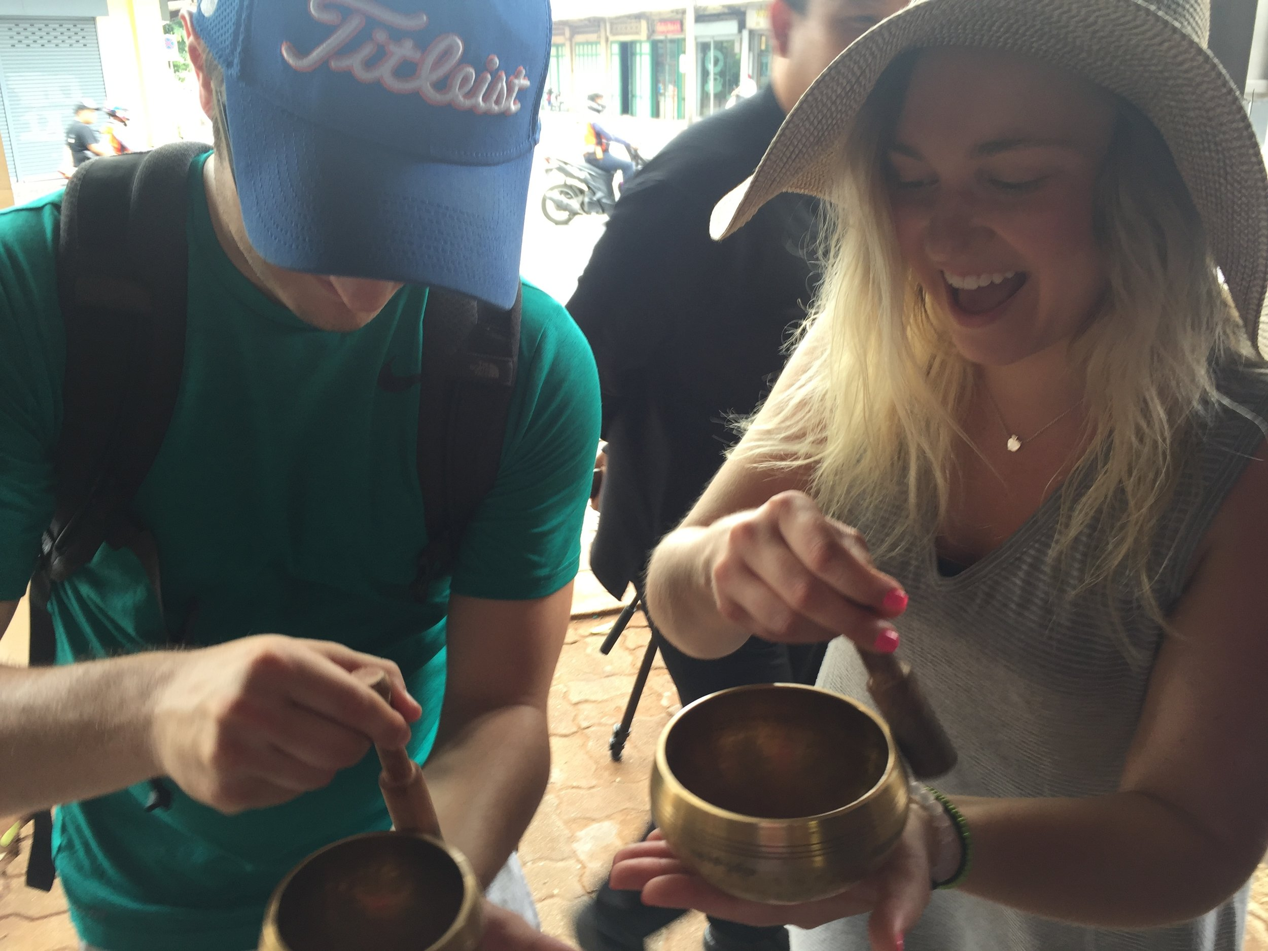 Gabbi and Charlie making music with the monk's bowls