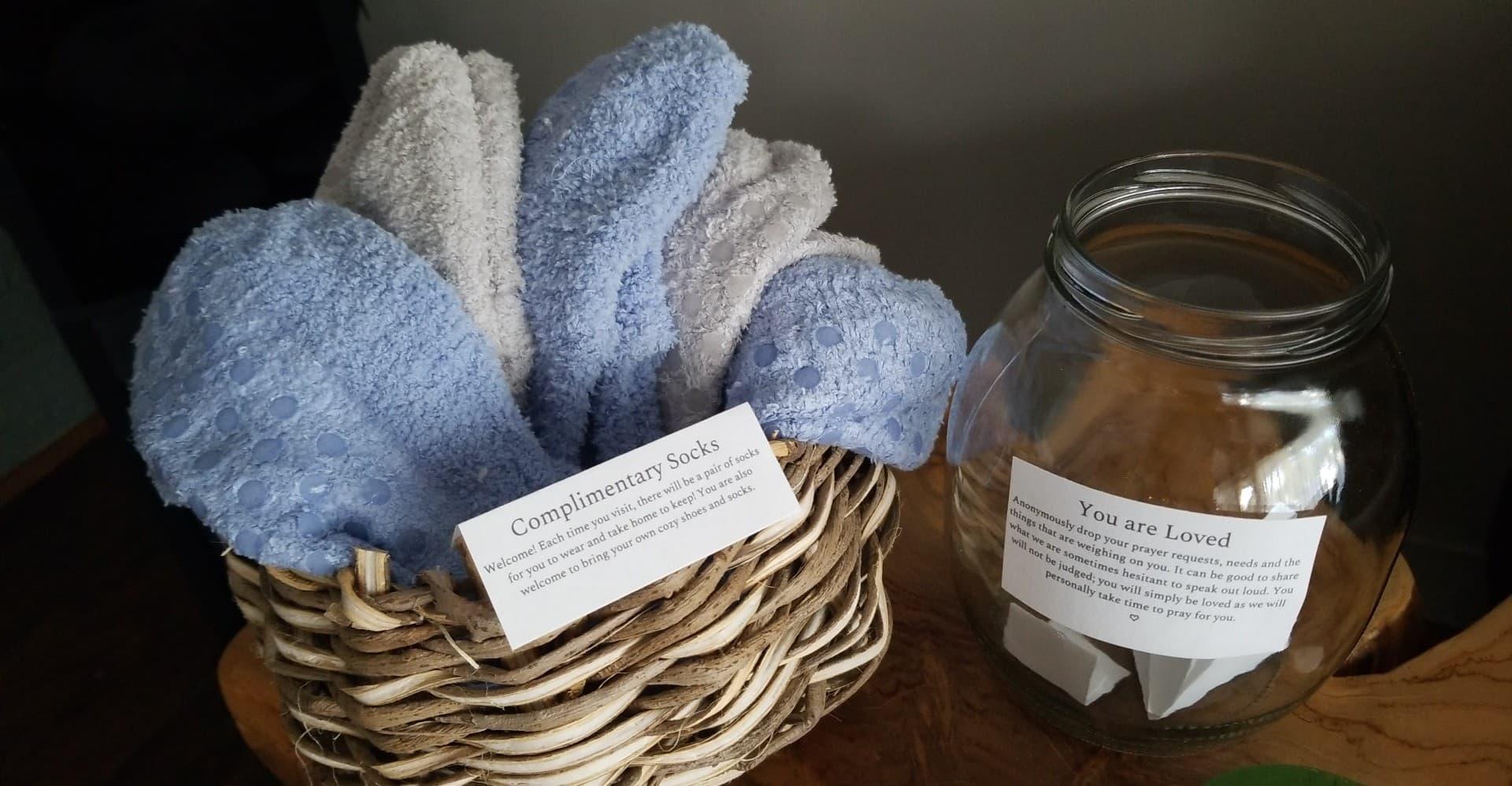 Comfy fuzzy socks and a prayer jar at the Jasper & Fern Self Care Lounge in downtown Winston-Salem, NC