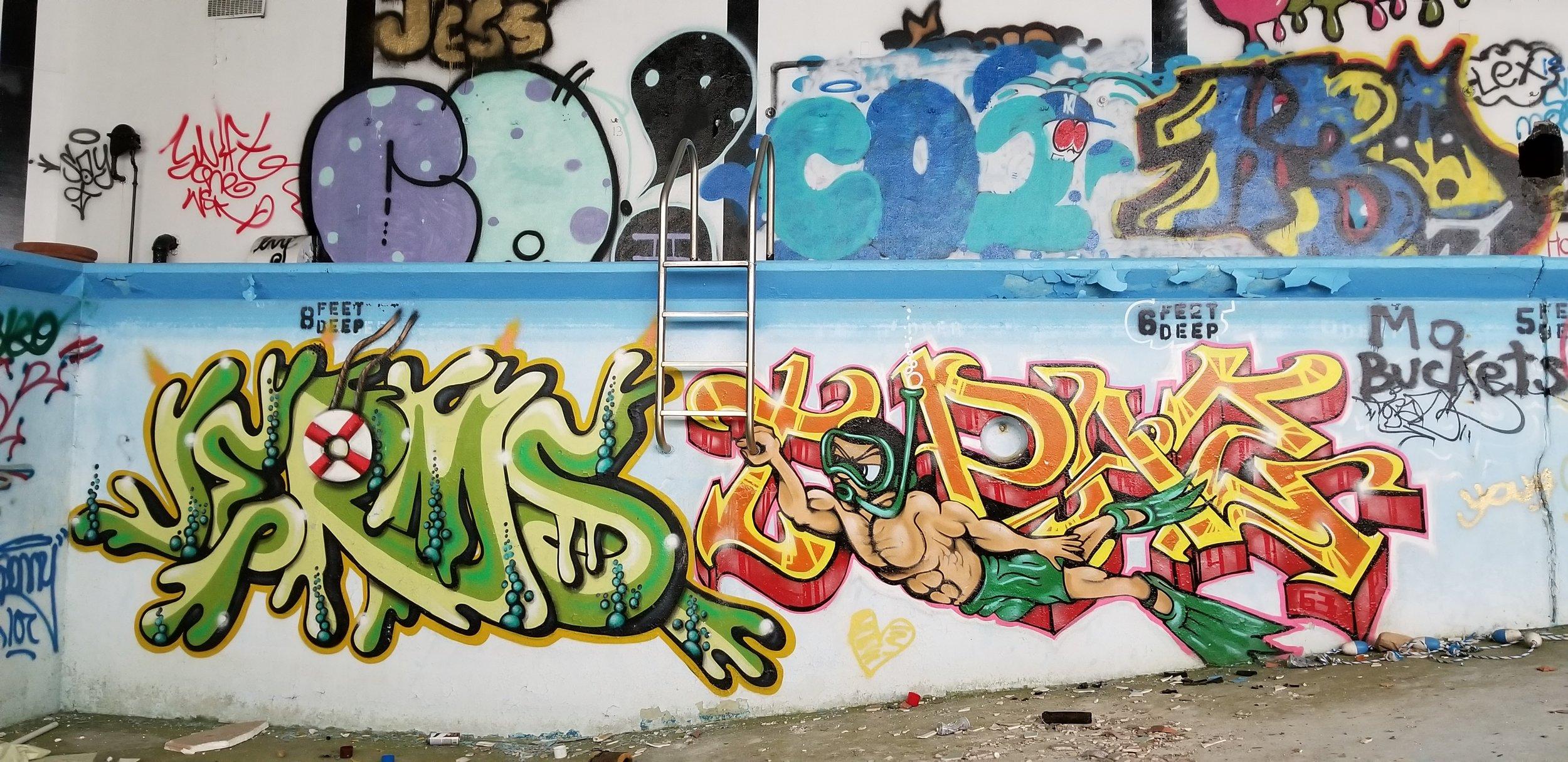 Graffiti in the Homowack lodge pool, taken 2018