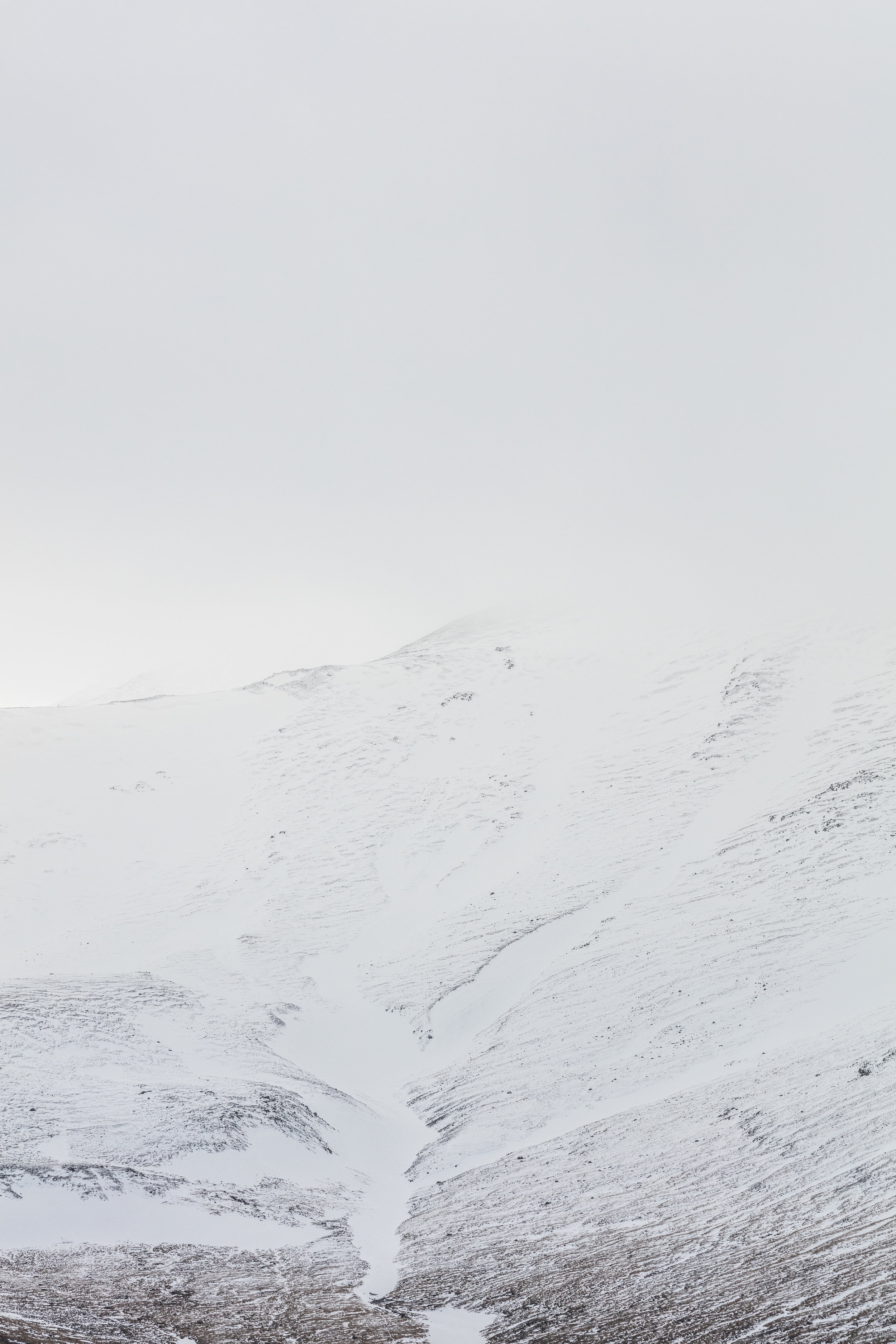 Misty Snow Capped Mountains and Valleys, Iceland | The Fox Plateau - Faune