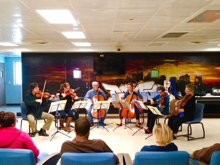 Sarasa musicians performing for a residency in a local Juvenile Facility