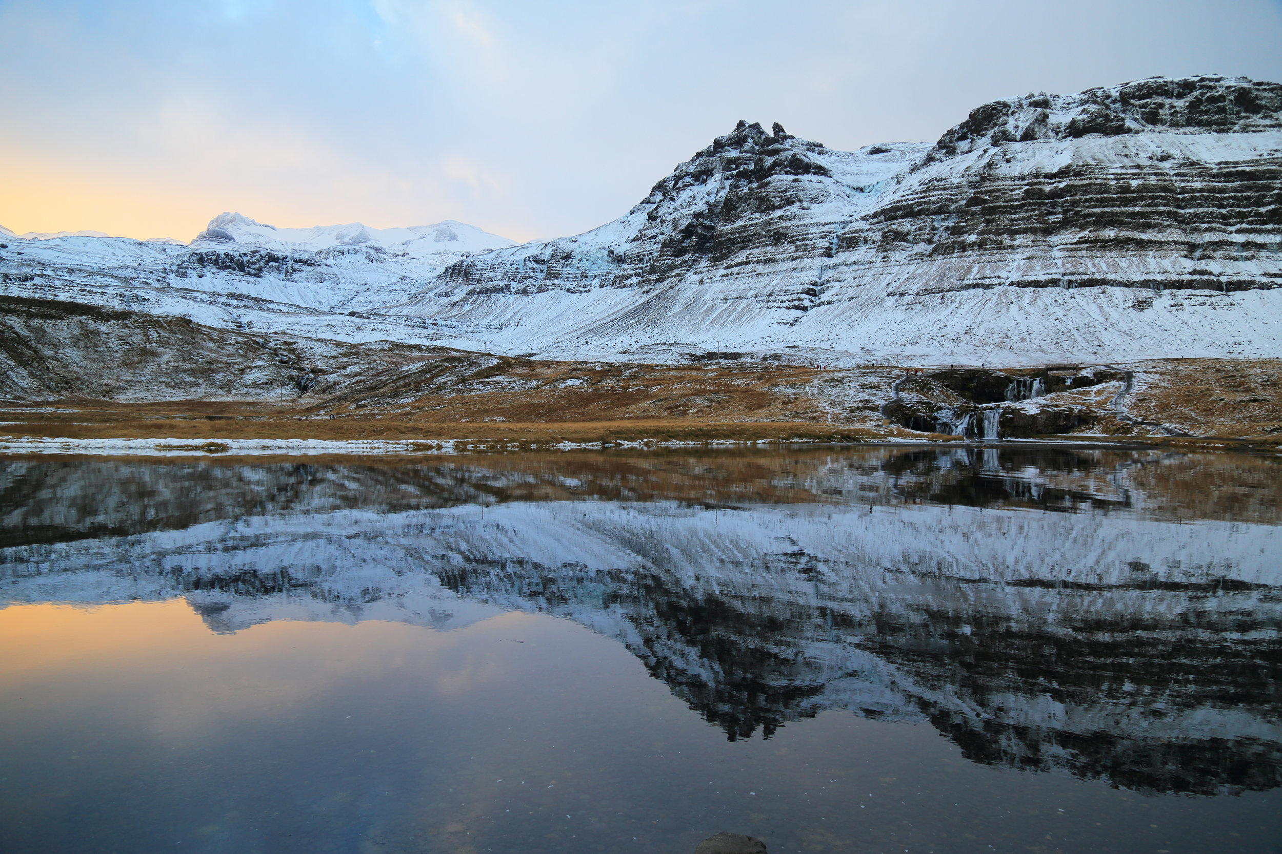 Kirkjufellsfoss and its reflection at sunrise