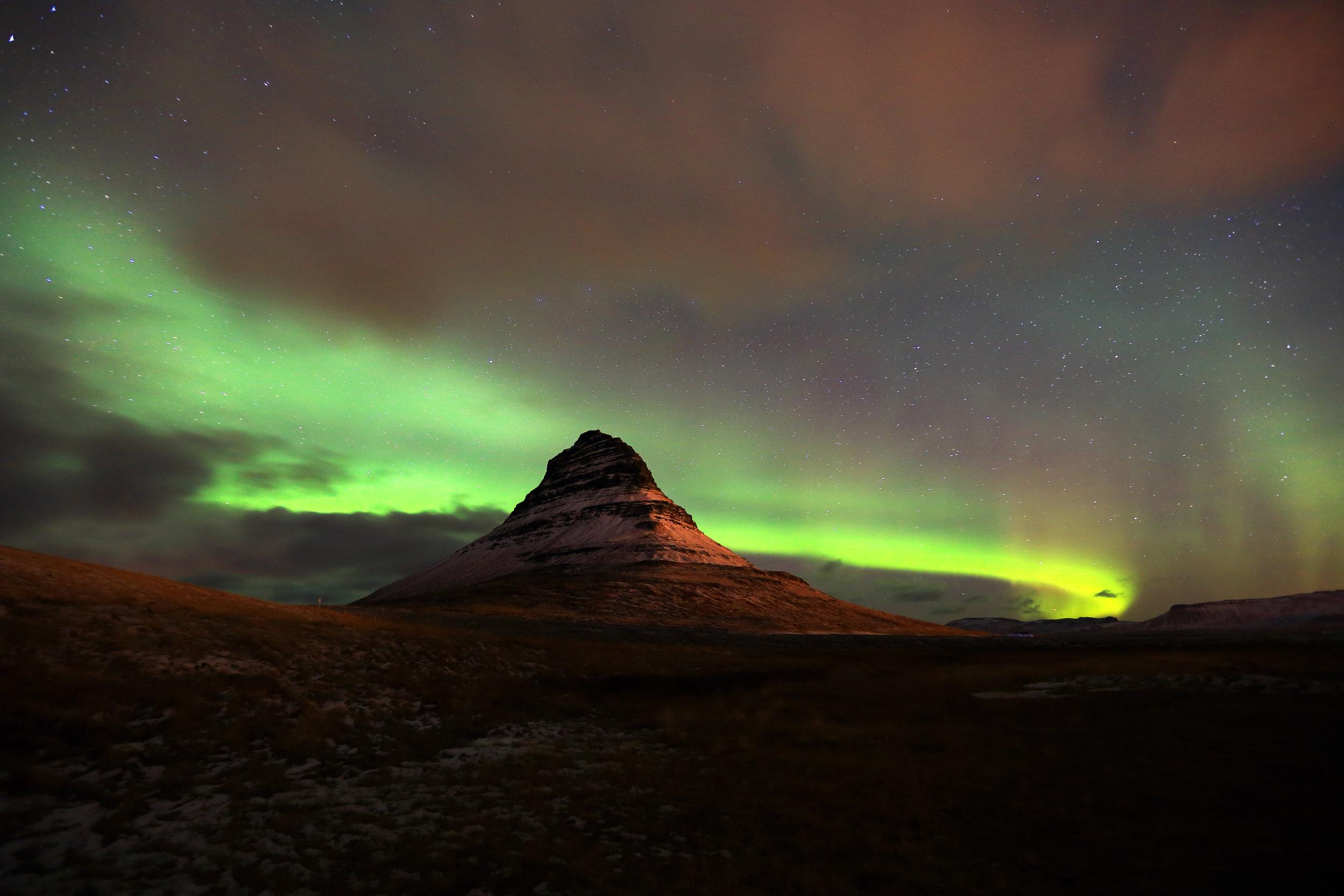 Aurora borealis dancing over Kirkjufell