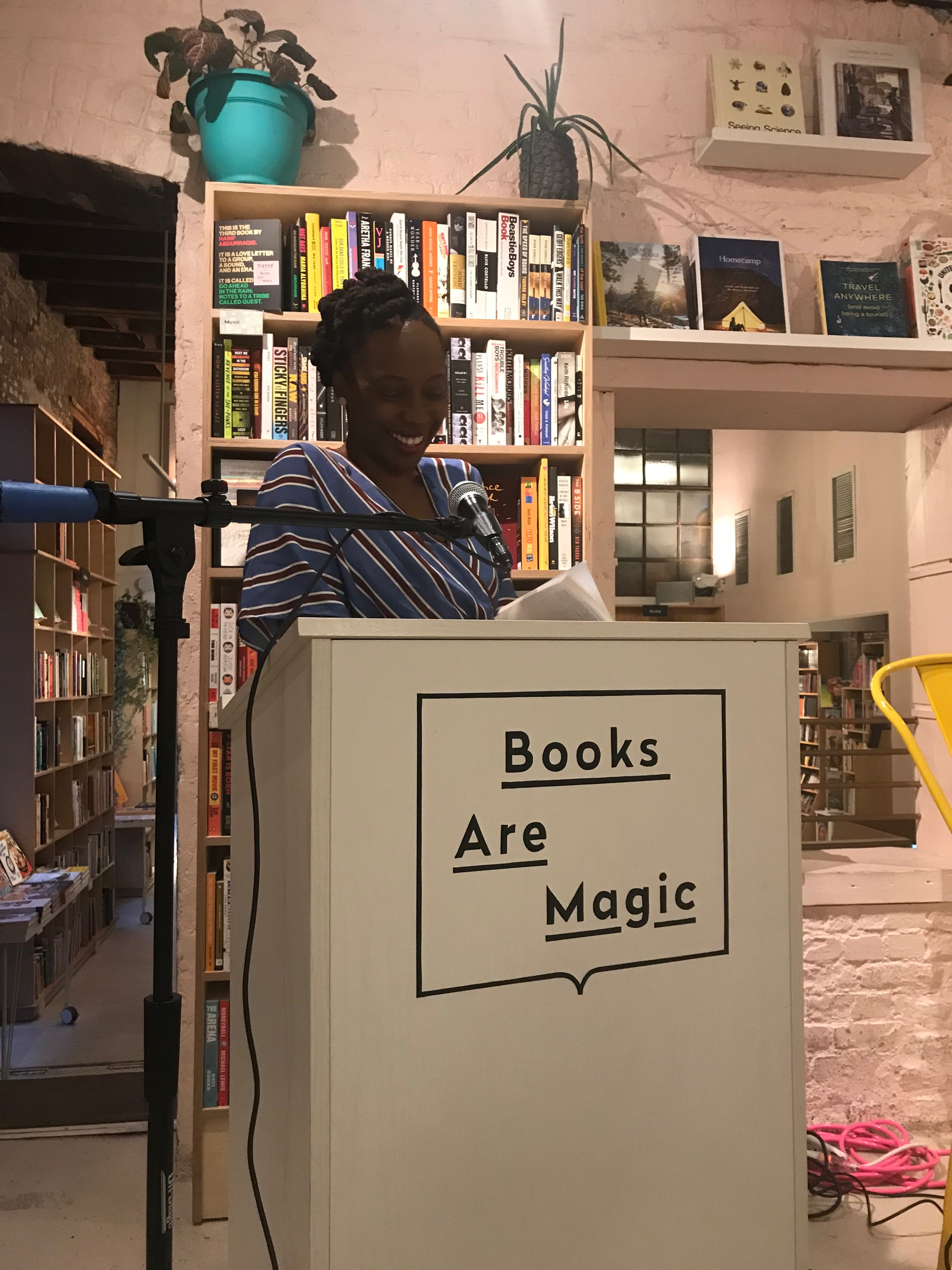 Author Bassey Ikpi reading a passage at Books Are Magic event in Brooklyn August 21st Photo Credit : Storm Jenkins