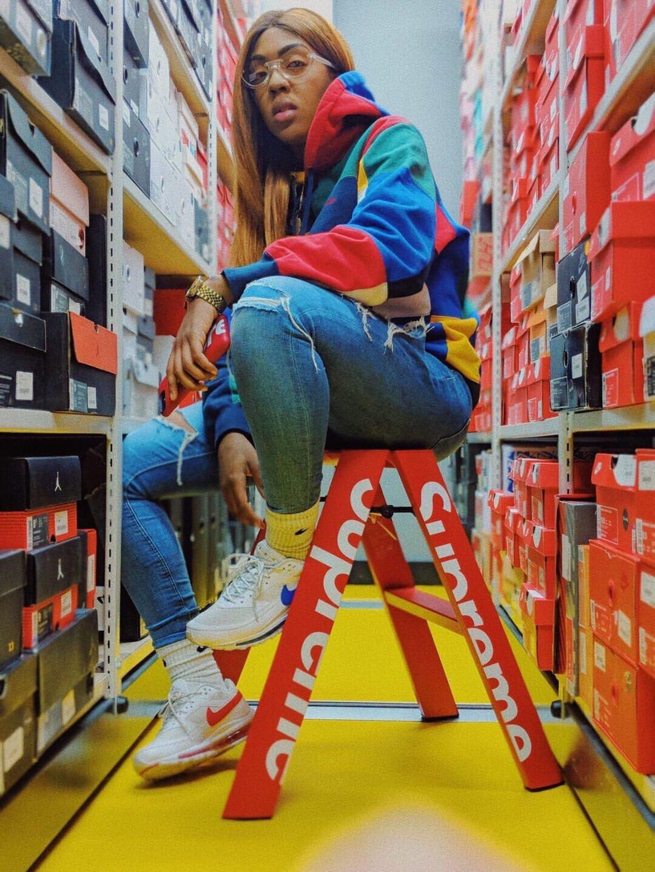 Elle Sneaks in stock room rocking the Skepta Nike SK Air 2 at Presented By. Photo Credit Elle Sneaks Instagram