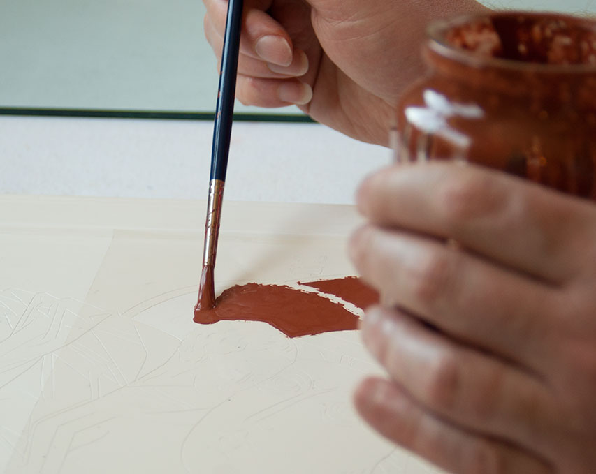 Red clay bole is applied over a masking film.