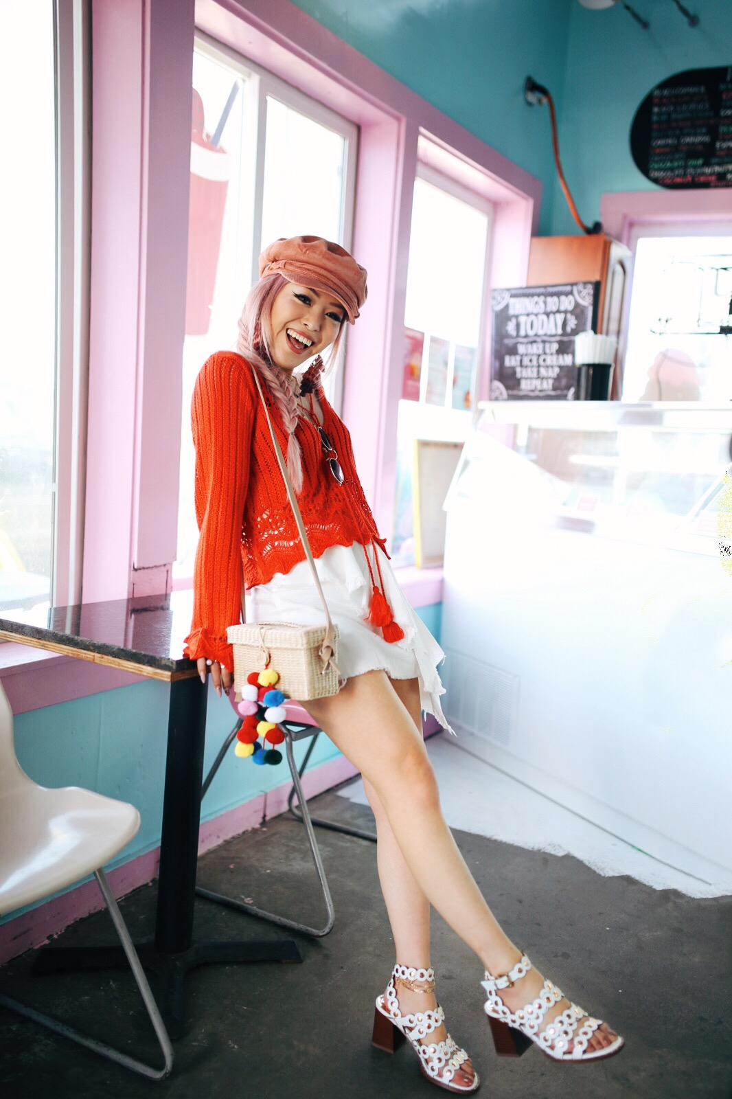 AD181B51-B6D3-44B5-A246-F0348812BD47.JPGRiver Island Pink cord baker boy hat-Pink ombre tassel drop earrings-Red crotchet knit tassel crop top-White frill denim skort-White scallop block heel sandals-Shein Straw box bag with pom pom-Aikas Love Closet-Seattle Style Fashion Blogger-Japanese-Pink Hair-Side fishtail braid-summer style-smile 10