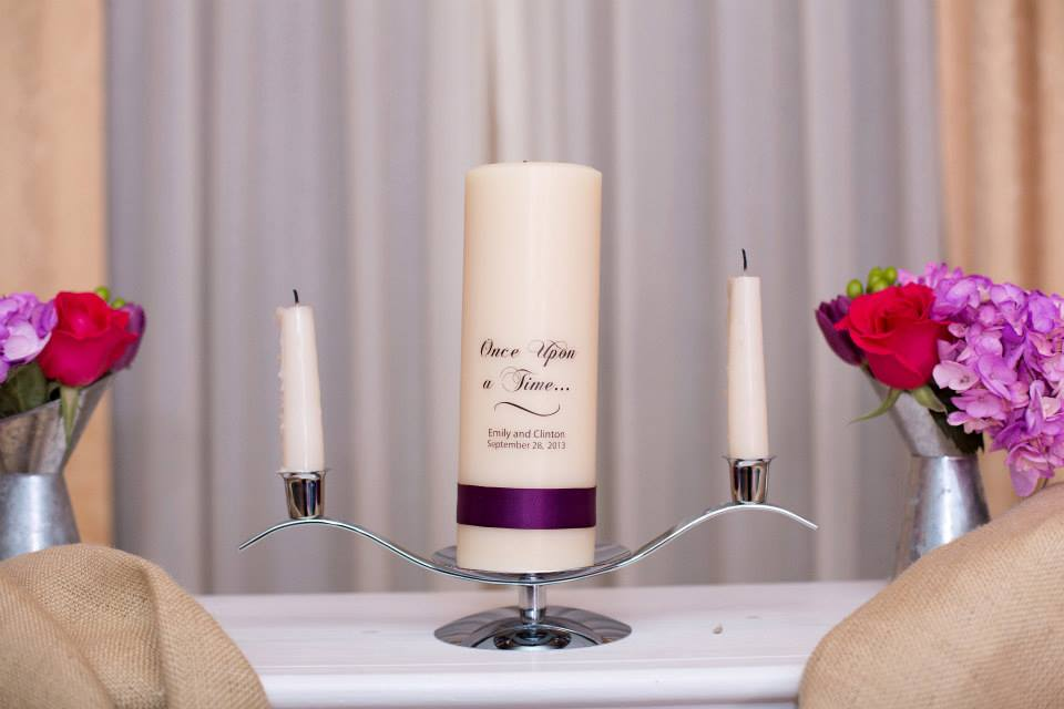 Another subtle fairytale touch with the unity candle. Photo Credit: http://sugarsnapatl.com