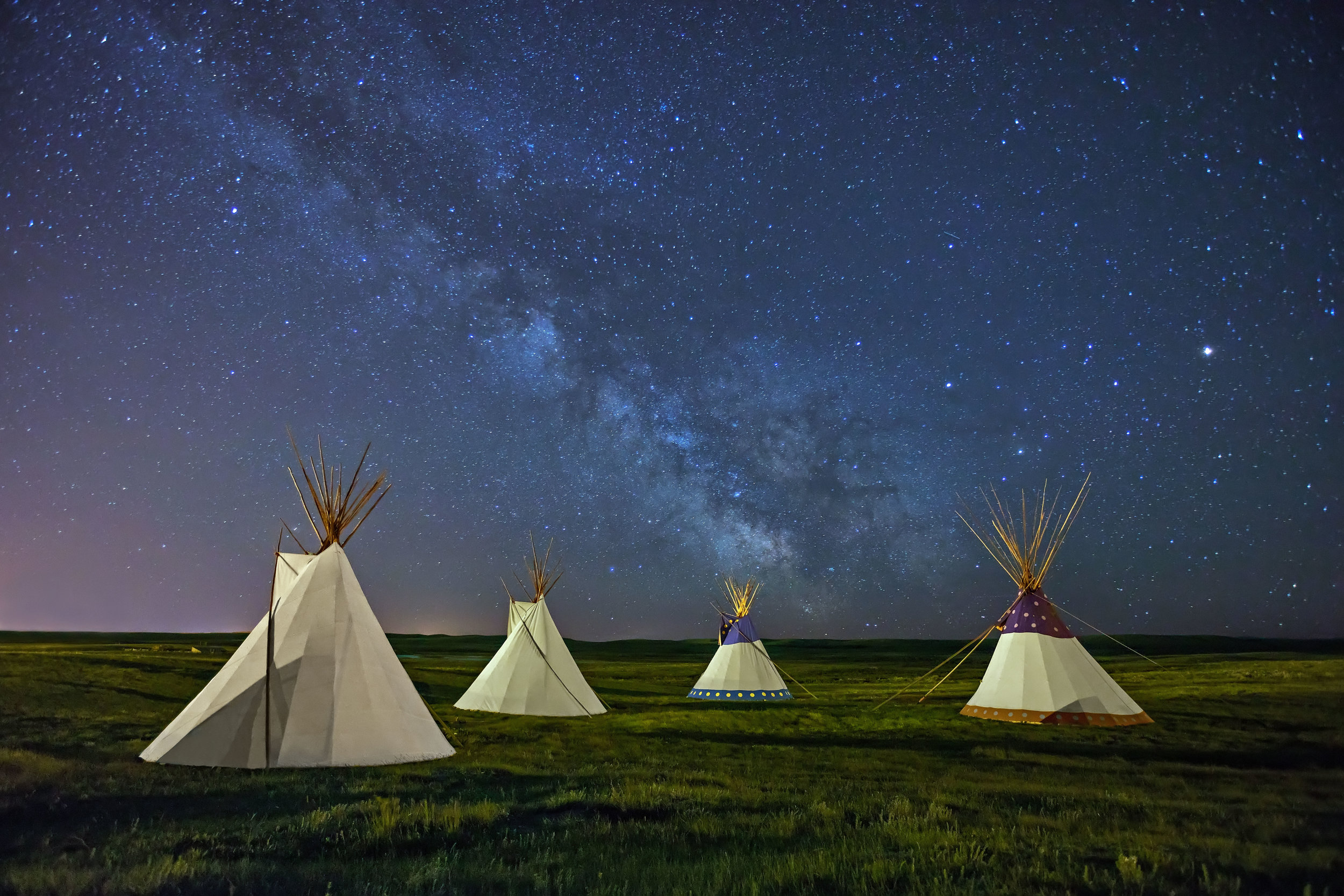 Milky Way over Blackfeet Indian Reservation Tipis in Montana