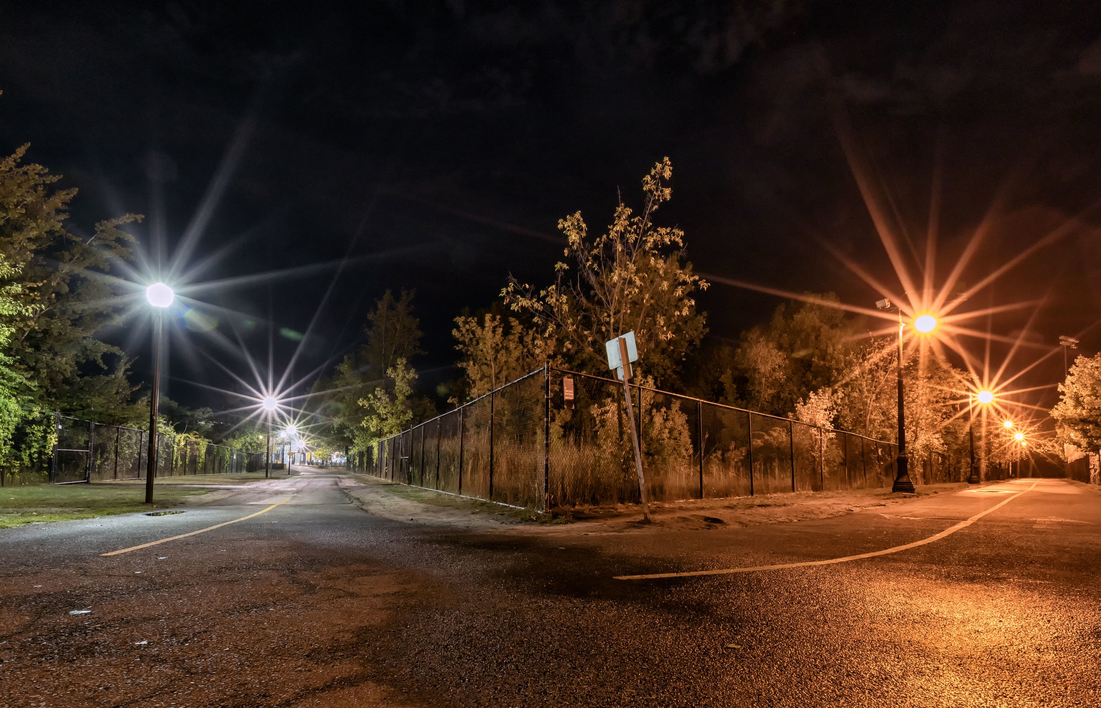 A street undergoing LED retrofitting, lit half in Sodium Vapor (right) and half in LED (left)