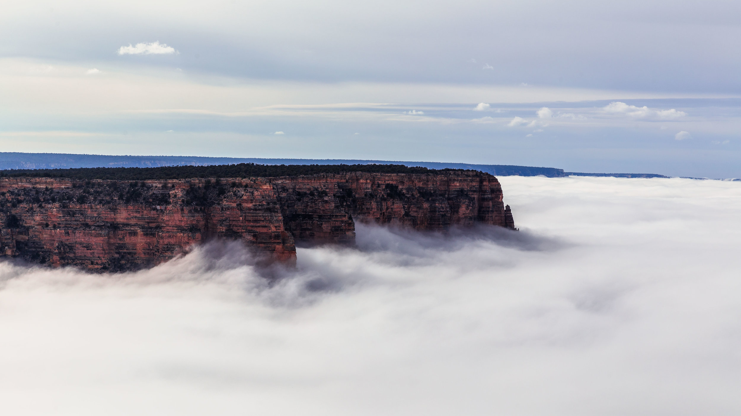 This isn't an ocean lapping at the shore — it's clouds inside the Grand Canyon