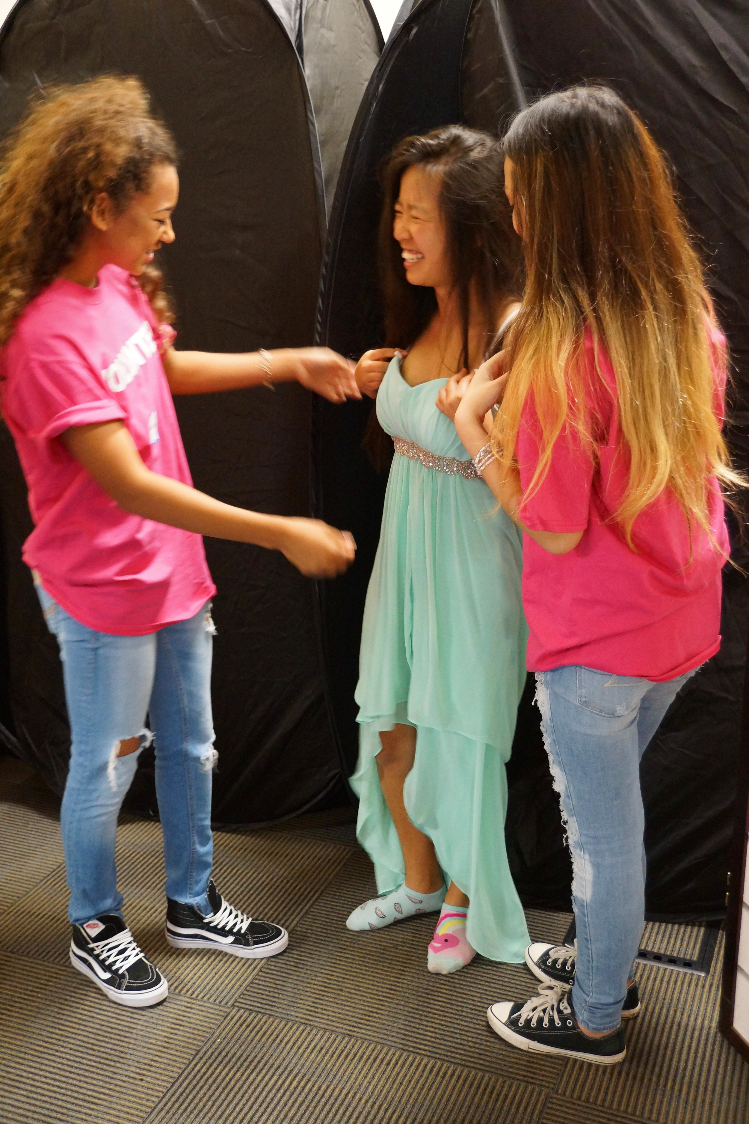 Teens enjoying trying on dresses for the dance!