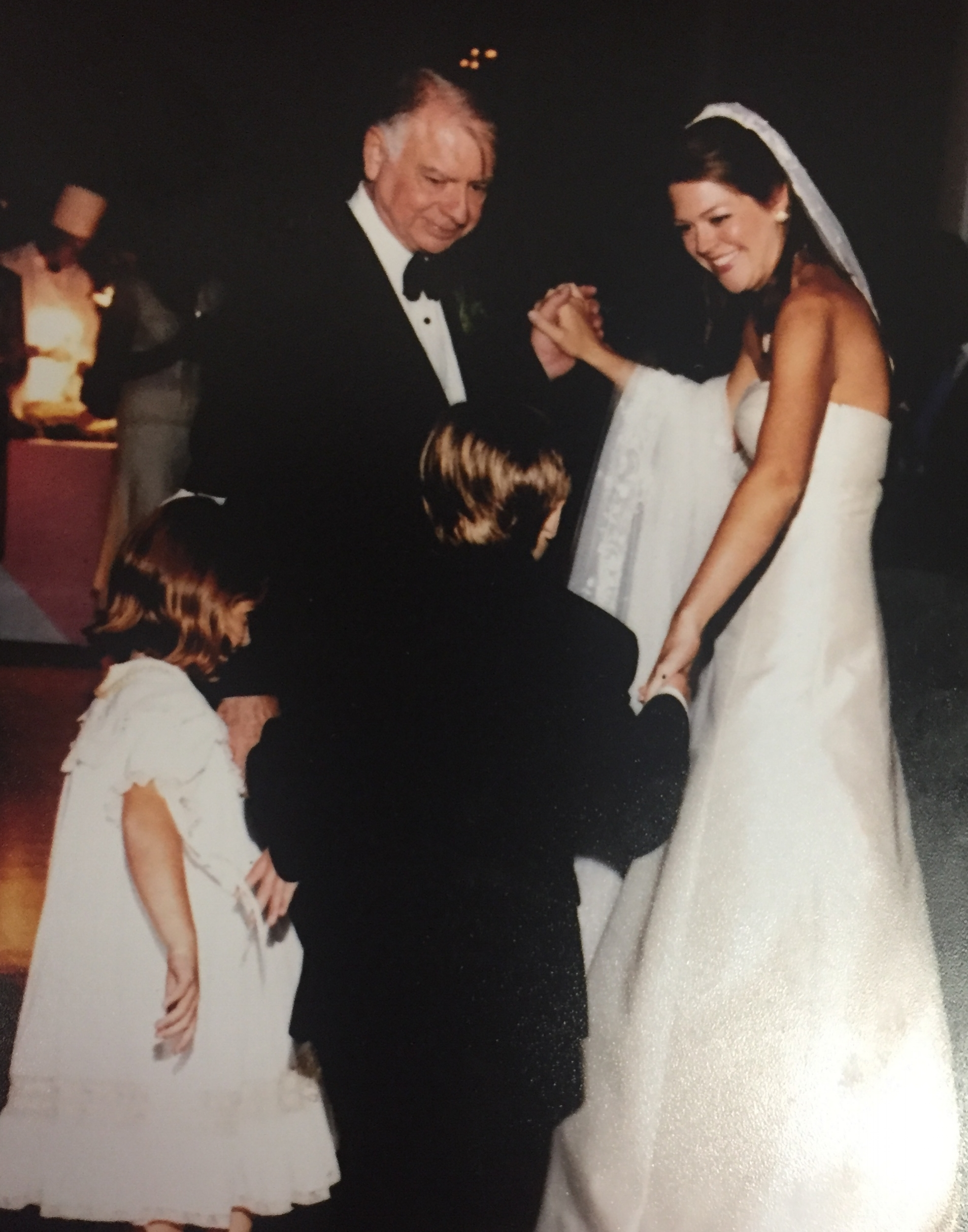 Photo is of Andrew, left, and his daughter Katie, the bride, with Trot, whose back is facing the camera, and his granddaughter.