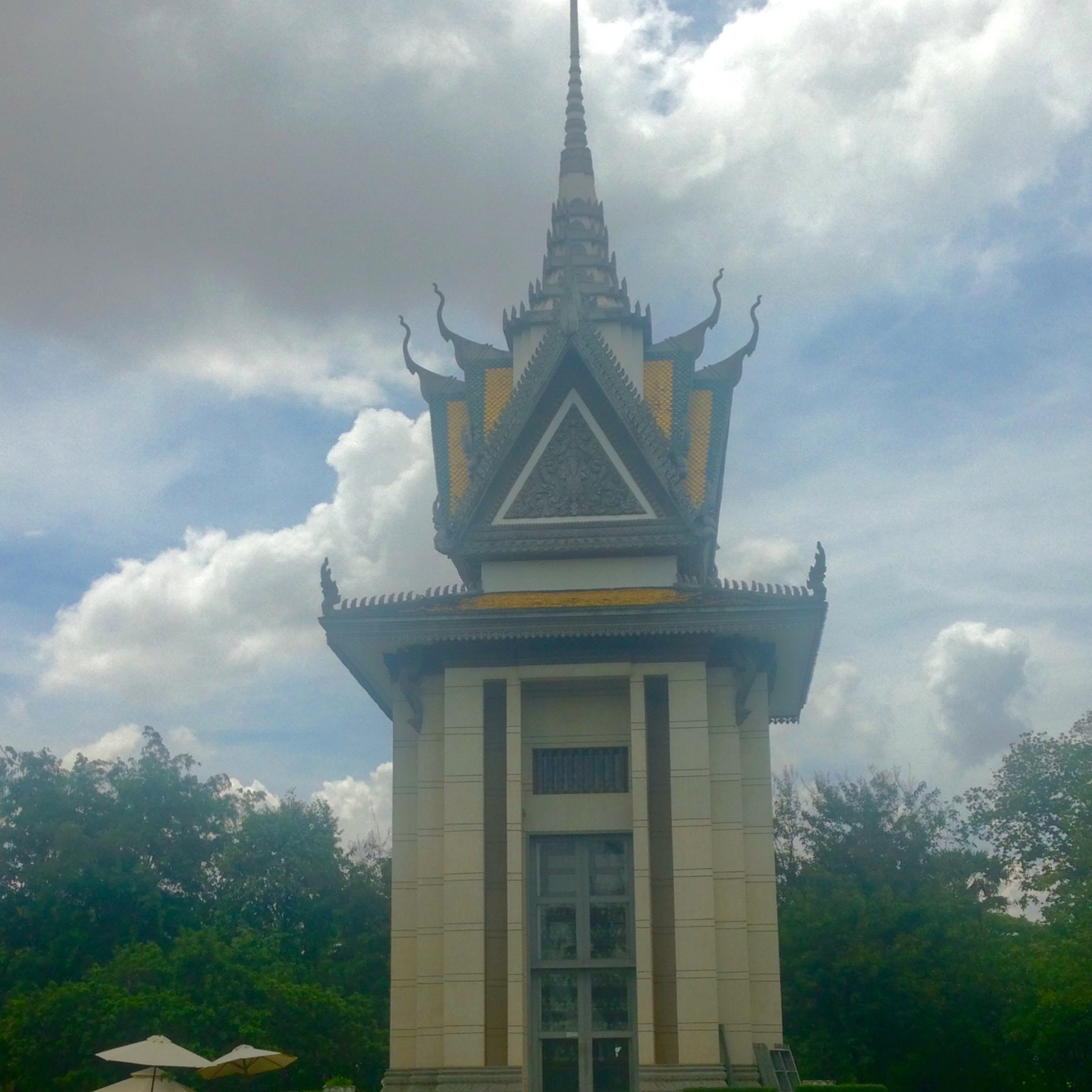 Stupa at Choeng Ek, filled with the skulls of the victims of Khmer Rouge