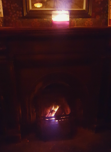 Warming up by the fire with a whiskey