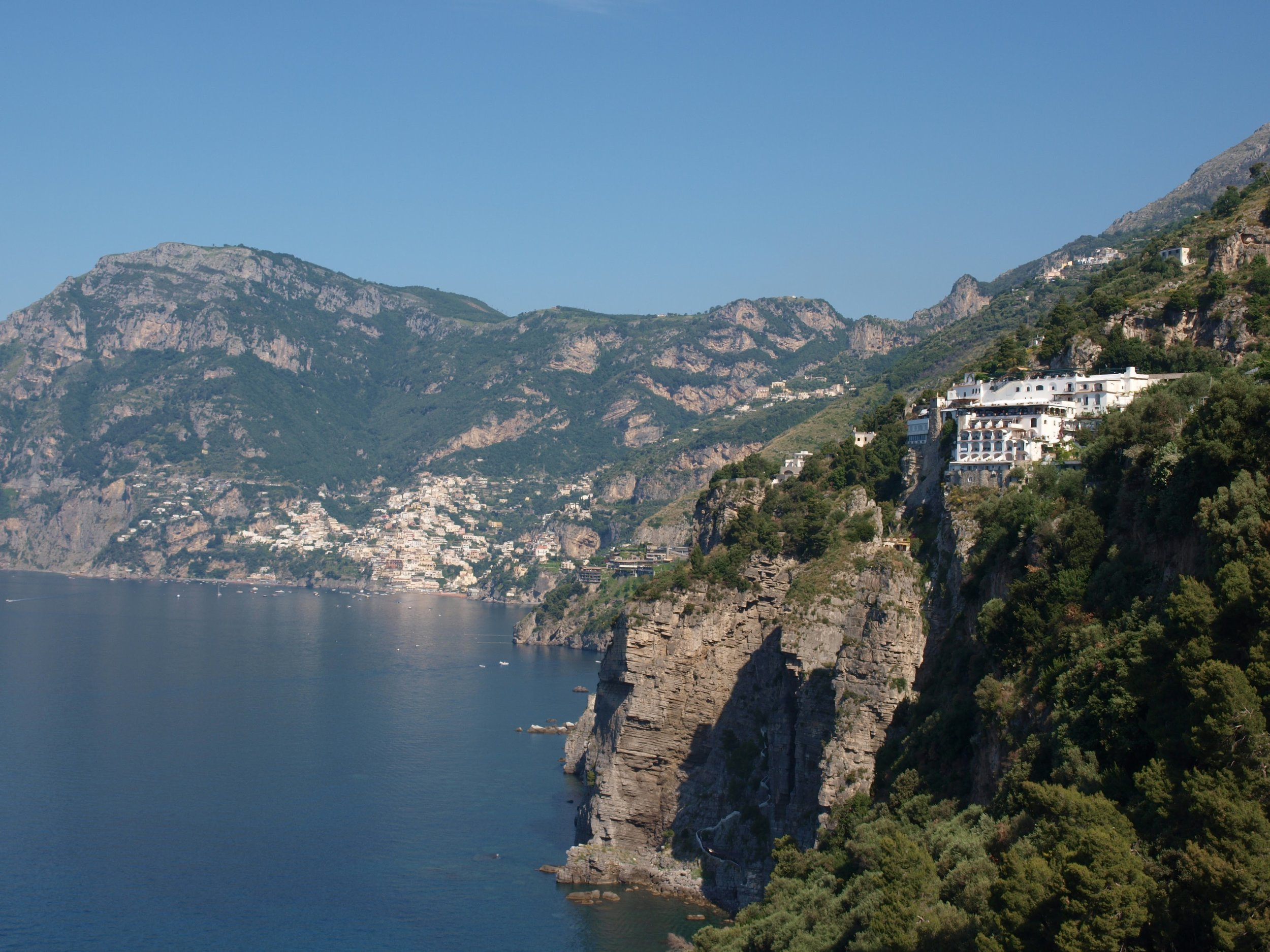 The hotel Tramonto d'Oro perched high on the cliff