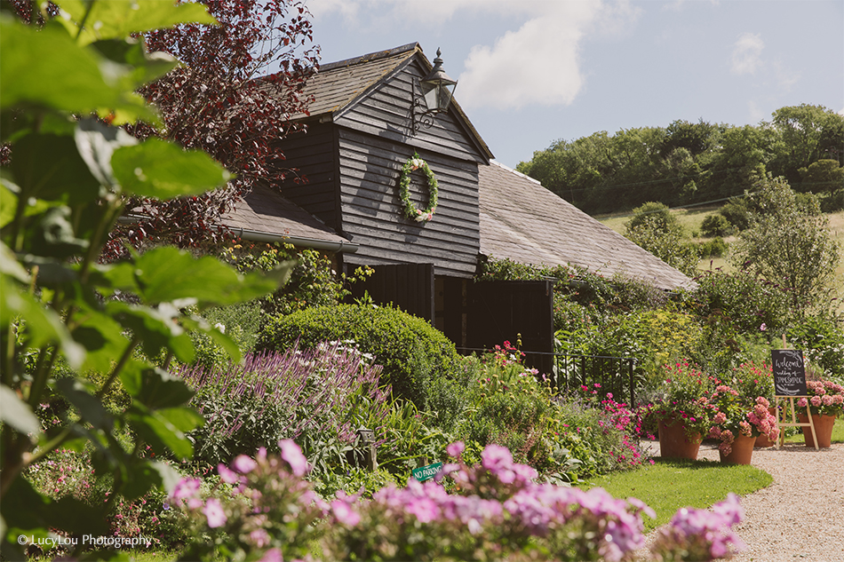 Upwaltham Barns east-barn-in-bloom-wedding-venues-sussex.jpg