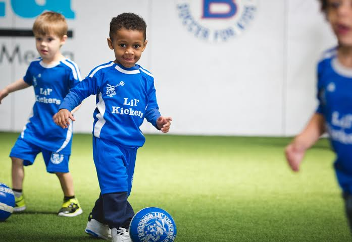 three year old soccer dribbling
