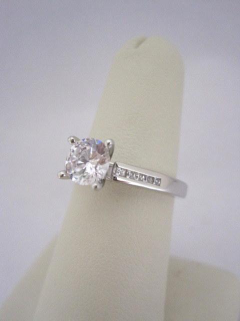 Diamond Engagement Ring with Channel Set Princess Cut Diamonds