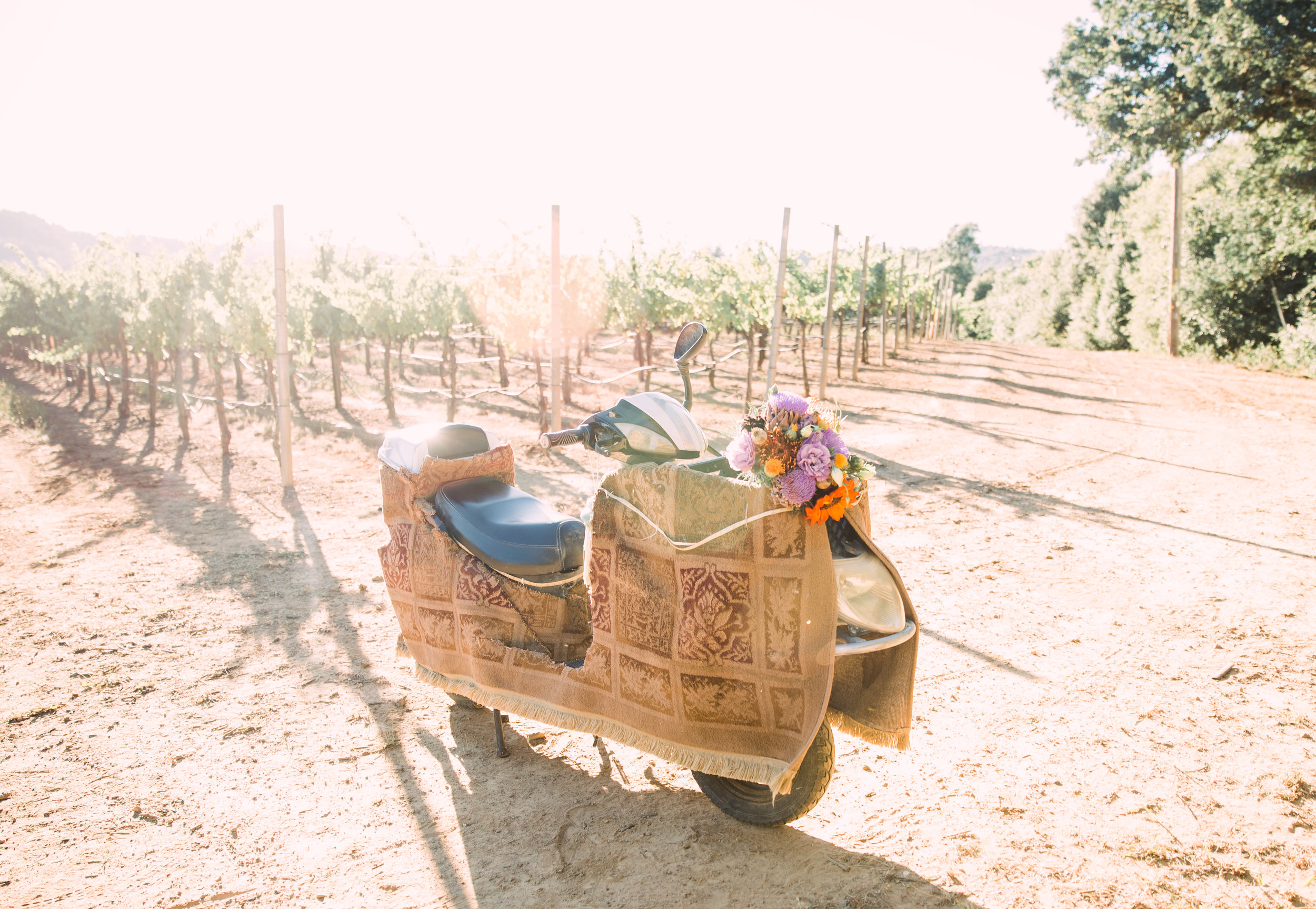 "Their beloved ""Scoot Scoot"" which has seen many an adventure from Burning Man to, well zooming around the Vineyards on their wedding day."