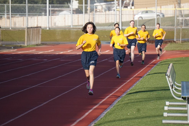 Cadet Kaitlin Lew (9) leads Patriot Company's Physical Fitness Team as they complete the mile run portion of the physical fitness competition.