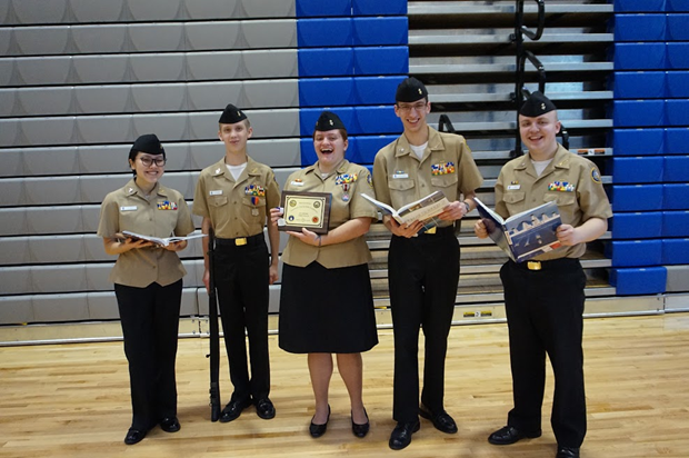Patriot Company's Academics Team, consisting of Cadets Khanh Dao (10), Carson tucker (10), Lenna Weiss (12), Evan Rosenfelt (11), and Jacob Hill (11), show off their award for finishing first in the academics competition.