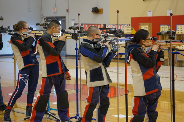 From left to right: Cadets Olivia Van Ry (11), Christopher Lew (11), Chandler Alexander (12), and Mathea Caole take aim during the precision air rifle competition. Mathea Caole led the team with a season high 572 out of a possible 600.