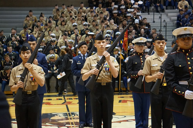 Cadets Daniel Tsang, Carson Tucker, and Christoper Lew compete during the Individual Armed Drill Down.