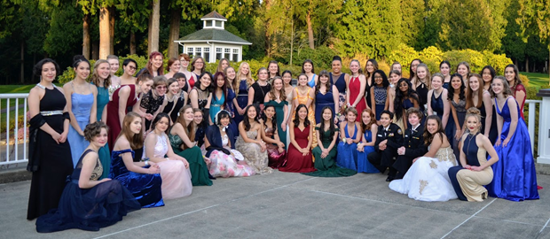 Female cadets and guests gather on the Sahalee Country Club balcony for group photo before the start of the official Navy Ball ceremony.