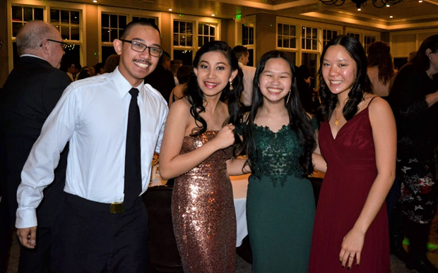 From left to right: Cadets Tim Caole, Tam Caole, Hannah Nguyen and Emily Lew take a brake from the dance floor at the annual NJROTC Navy Ball.